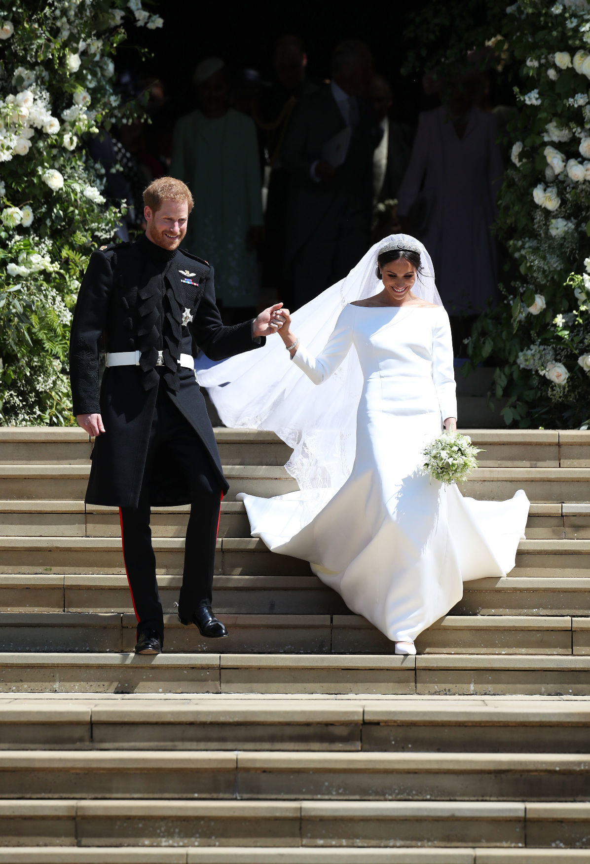 WINDSOR, UNITED KINGDOM - MAY 19:  Prince Harry and Meghan Markle leave St George's Chapel after their wedding in St George's Chapel at Windsor Castle on May 19, 2018 in Windsor, England. (Photo by Jane Barlow - WPA Pool/Getty Images)