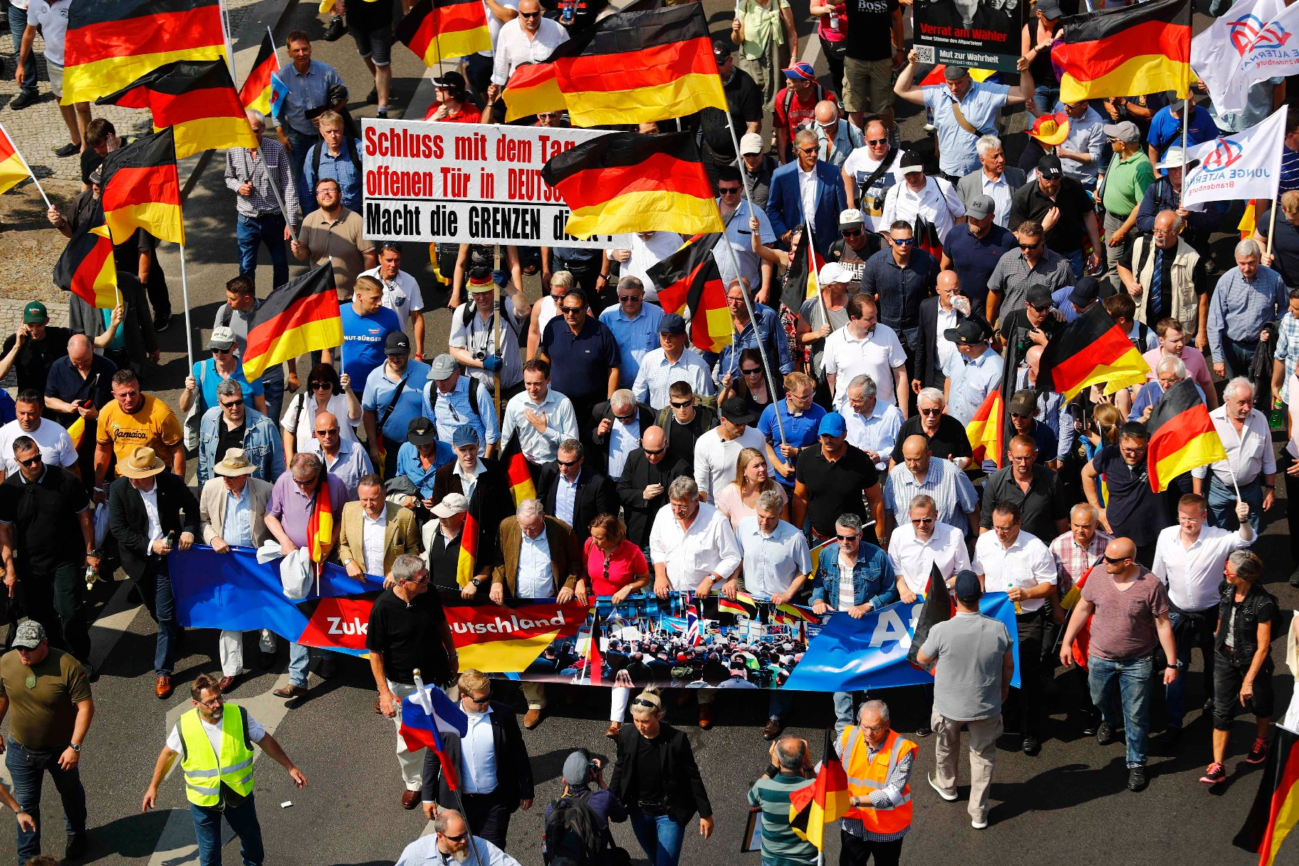 Supporters of the Anti-immigration party Alternative for Germany (AfD) walk during a protest in Berlin, Germany May 27, 2018. REUTERS/Hannibal Hanschke