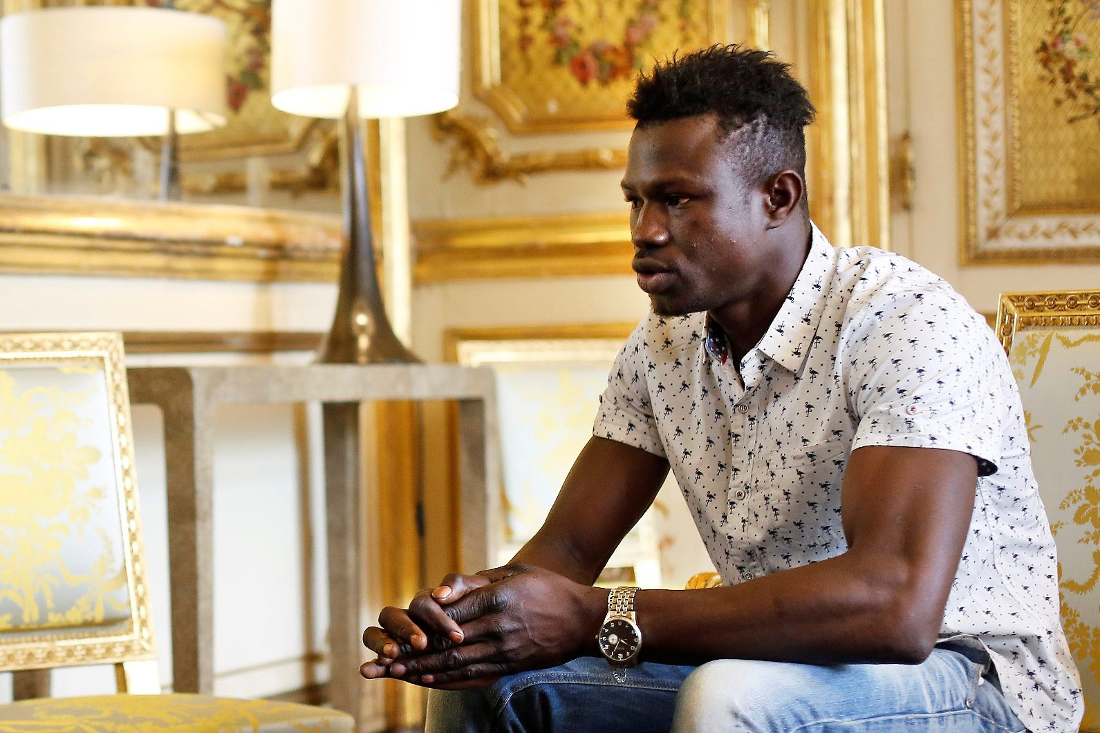 Mamoudou Gassama, 22, from Mali, is pictured during a meeting with French President Emmanuel Macron at the Elysee Palace in Paris, France, May 28, 2018. Mamoudou Gassama living illegally in France is being honored by Macron for scaling an apartment building over the weekend to save a 4-year-old child dangling from a fifth-floor balcony. Thibault Camus/Pool via Reuters