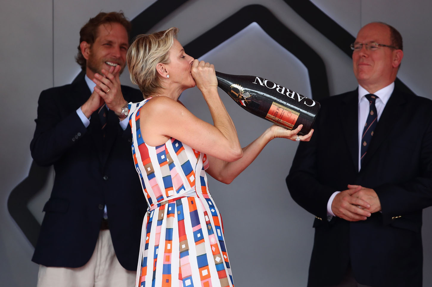 MONTE-CARLO, MONACO - MAY 27:  Princess Charlene of Monaco drinks the winner champagne on the podium during the Monaco Formula One Grand Prix at Circuit de Monaco on May 27, 2018 in Monte-Carlo, Monaco.  (Photo by Mark Thompson/Getty Images)