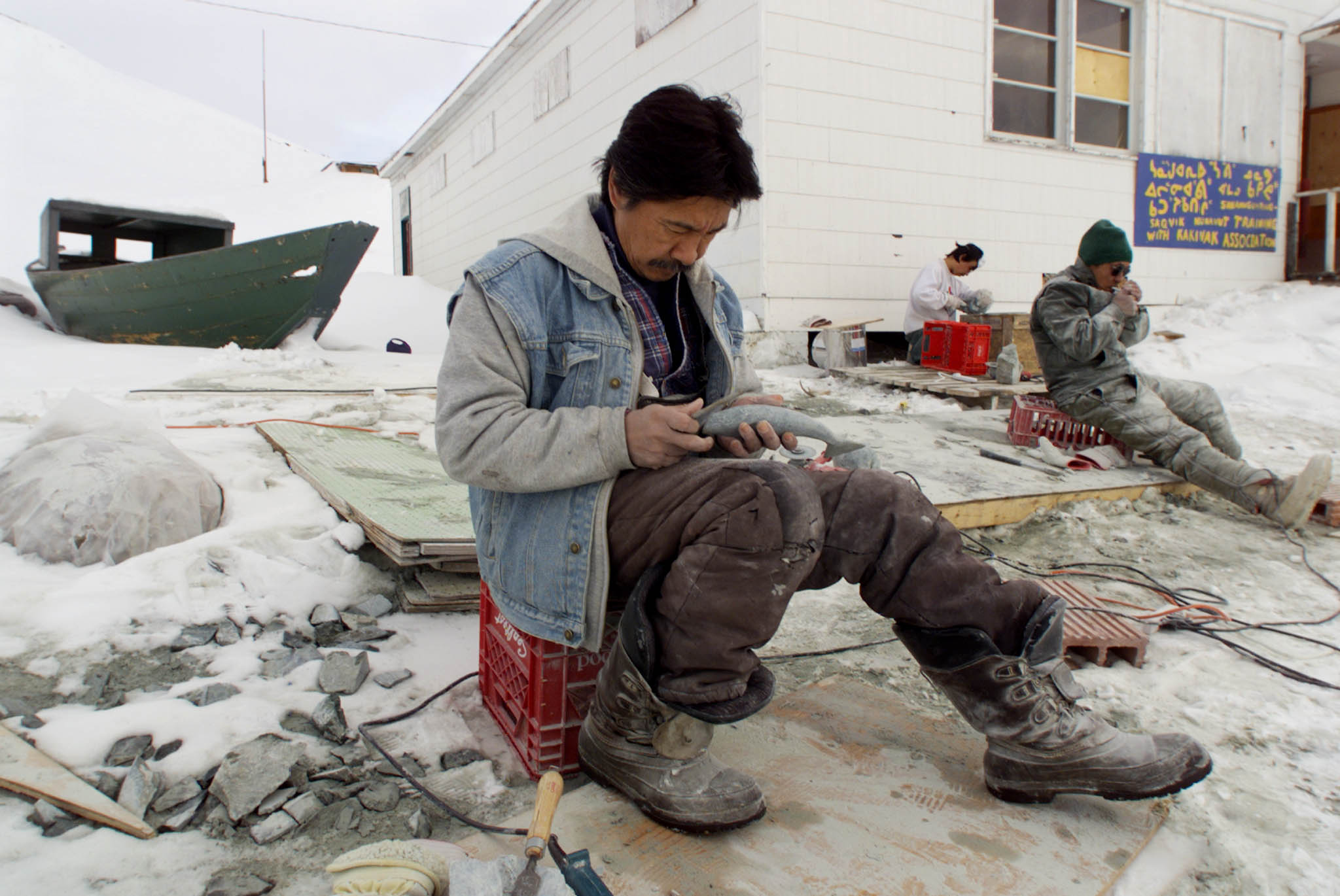 Inuit carvers work on their art on the shore of Frobisher Bay in the arctic town of Iqaluit, March 29. Nunavut, which has a population of 25,000 and covers over two million square kilometers of arctic terrain, will become a new Canadian territory April 1.  SB/MR/HB/WS - RP1DRIKVSFAF