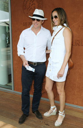 Hugh Grant opted not to wear his wedding ring as he and wife Anna Eberstein take a stroll at Le Village de Roland Garros, during the 2018 Tennis French Open. June 10, 2018 in Paris, France. USA ONLY