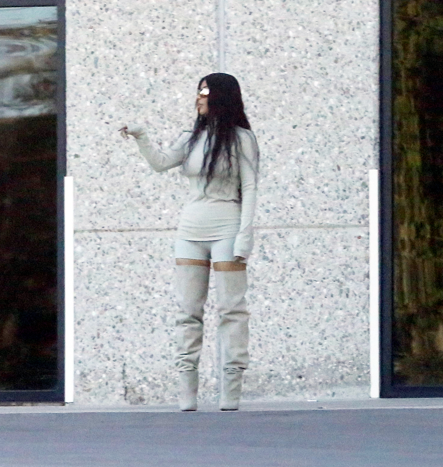 PREMIUM EXCLUSIVE Please contact X17 before any use of these exclusive photos - x17@x17agency.com   Kim Kardashian strikes a pose in a pair of sexy thigh high boots and figure hugging booty shorts for a photo shoot in Calabasas. June 11, 2018  akra/X17online.com