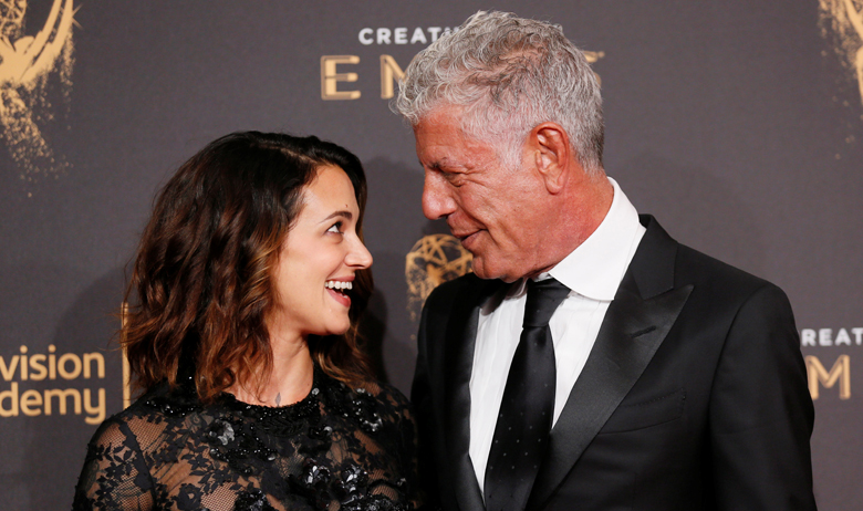 Chef Anthony Bourdain (R) and actor Asia Argento (L) pose at the 2017 Creative Arts Emmy Awards in Los Angeles, California September 9, 2017. REUTERS/Danny Moloshok - RC122828A400