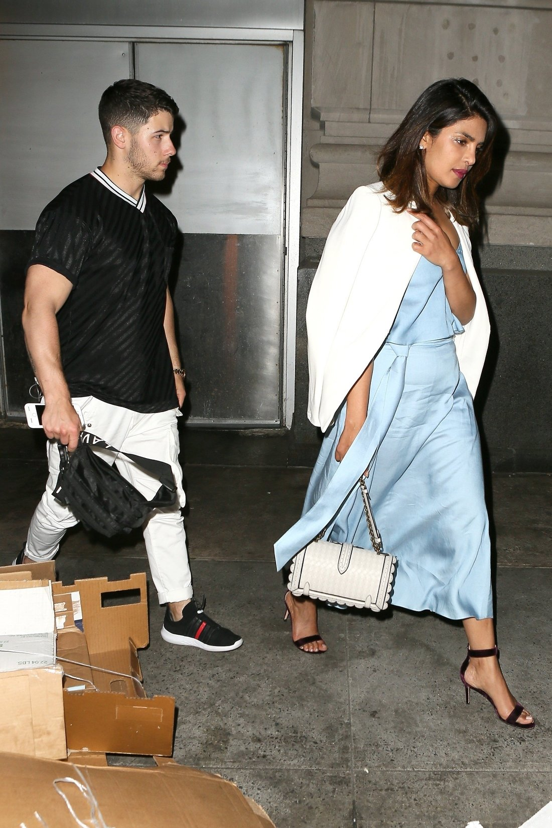 New York, NY  - Priyanka Chopra and Nick Jonas try to keep a low profile and avoid attention as they sneak out the back door of 'Park Avenue Summer' after having dinner. Priyanka kept her hand over her face as the pair got into the back seat of their waiting car.  Pictured: Priyanka Chopra, Nick Jonas    *UK Clients - Pictures Containing Children Please Pixelate Face Prior To Publication*, Image: 374723659, License: Rights-managed, Restrictions: , Model Release: no, Credit line: Profimedia, AKM-GSI