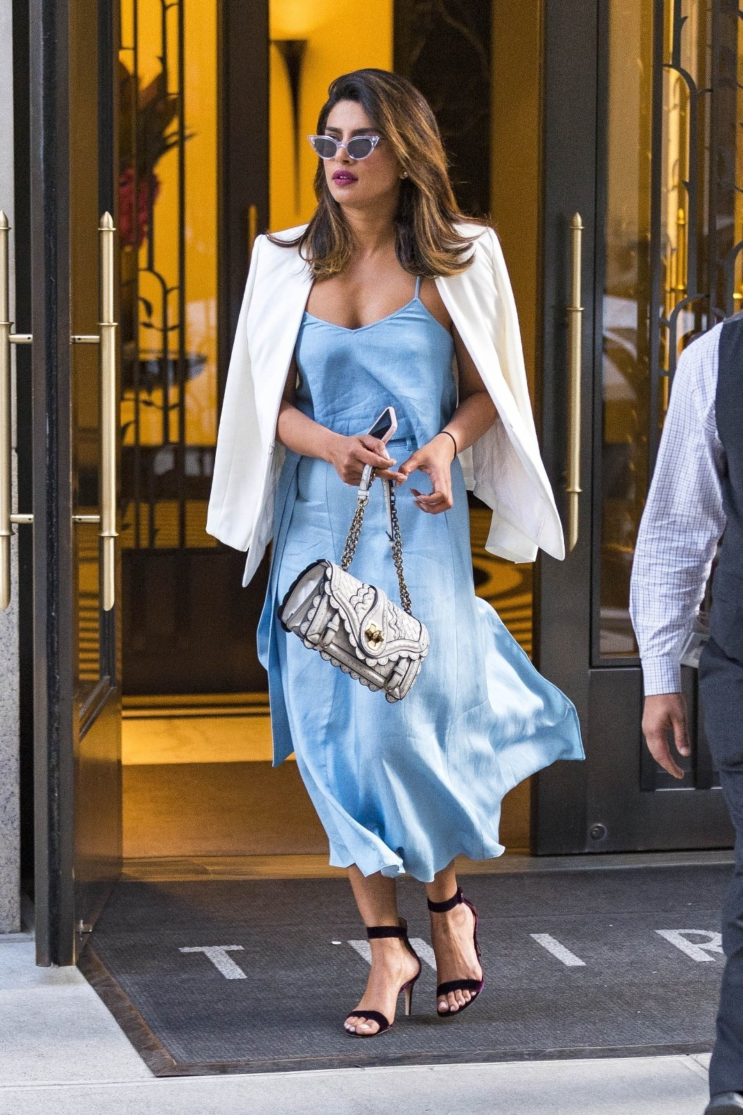 ** RIGHTS: WORLDWIDE EXCEPT IN BELGIUM, FRANCE, GERMANY, GREECE, NETHERLANDS, POLAND, PORTUGAL, SPAIN ** New York, NY  - Priyanka Chopra leaves her hotel in a baby blue dress, black heels and a white blazer headed to 'Park Avenue summer' to meet up with boyfriend Nick Jonas for a romantic dinner for two.  Pictured: Priyanka Chopra  BACKGRID USA 12 JUNE 2018, Image: 374715429, License: Rights-managed, Restrictions: , Model Release: no, Credit line: Profimedia, AKM-GSI