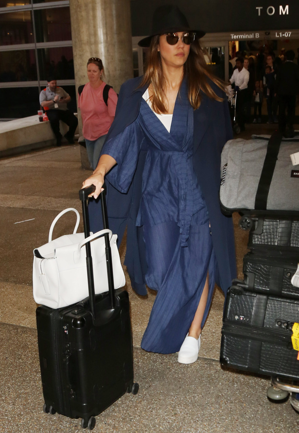 US: Jessica Alba arriving at the Los Angeles International Airport - LAX  Pictured: Jessica Alba Ref: SPL5003876 140618 NON-EXCLUSIVE Picture by: USDA / SplashNews.com  Splash News and Pictures Los Angeles: 310-821-2666 New York: 212-619-2666 London: 0207 644 7656 Milan: +39 02 4399 8577 photodesk@splashnews.com  World Rights, No France Rights, No Poland Rights