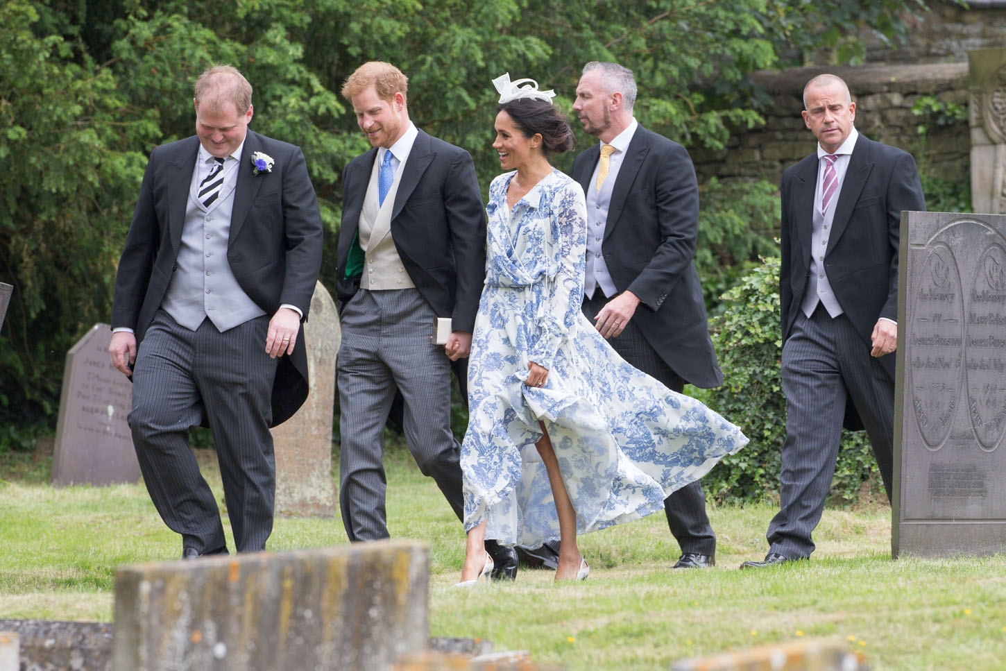 Meghan Markle and Prince Harry arriving for the wedding of Celia McCorquodale in Stoke Rochford, UK.  Meghan Markle and Prince Harry were seen smiling and laughing yesterday as they attended his cousin's wedding - with the bride wearing Princess Diana's tiara.  The new Duchess of Sussex stunned in a long-sleeved blue-and-white paisley shirt dress and white fascinator at the wedding of Princess Diana's niece, Celia McCorquodale - exactly four weeks after her big day.  Celia, who is the younger daughter of the Princess of Wales' sister Lady Sarah McCorquodale, looked beautiful in a lace-bodiced dress and a full veil, held in place by the stunning diamond tiara worn by Princess Diana at her wedding to Prince Charles in 1981.  Celia, 29, attended Prince Harry and Meghan's wedding exactly a month ago and she returned the favour by inviting the couple to her country wedding to George Woodhouse at St Andrew and St Mary's Church in Stoke Rochford, Lincolnshire.  Harry and Meghan looked delighted to be at the occasion as they arrived at the pretty country church holding hands and smiling and laughing with the other guests.  * No UK Papers Or Web * * OK For UK Mags After June 28th *  Pictured: Meghan Duchess of Sussex,Harry Duke of Sussex Ref: SPL5004400 160618 NON-EXCLUSIVE Picture by: Geoff Robinson Photography / SplashNews.com  Splash News and Pictures Los Angeles: 310-821-2666 New York: 212-619-2666 London: 0207 644 7656 Milan: +39 02 4399 8577 photodesk@splashnews.com  World Rights, No United Kingdom Rights