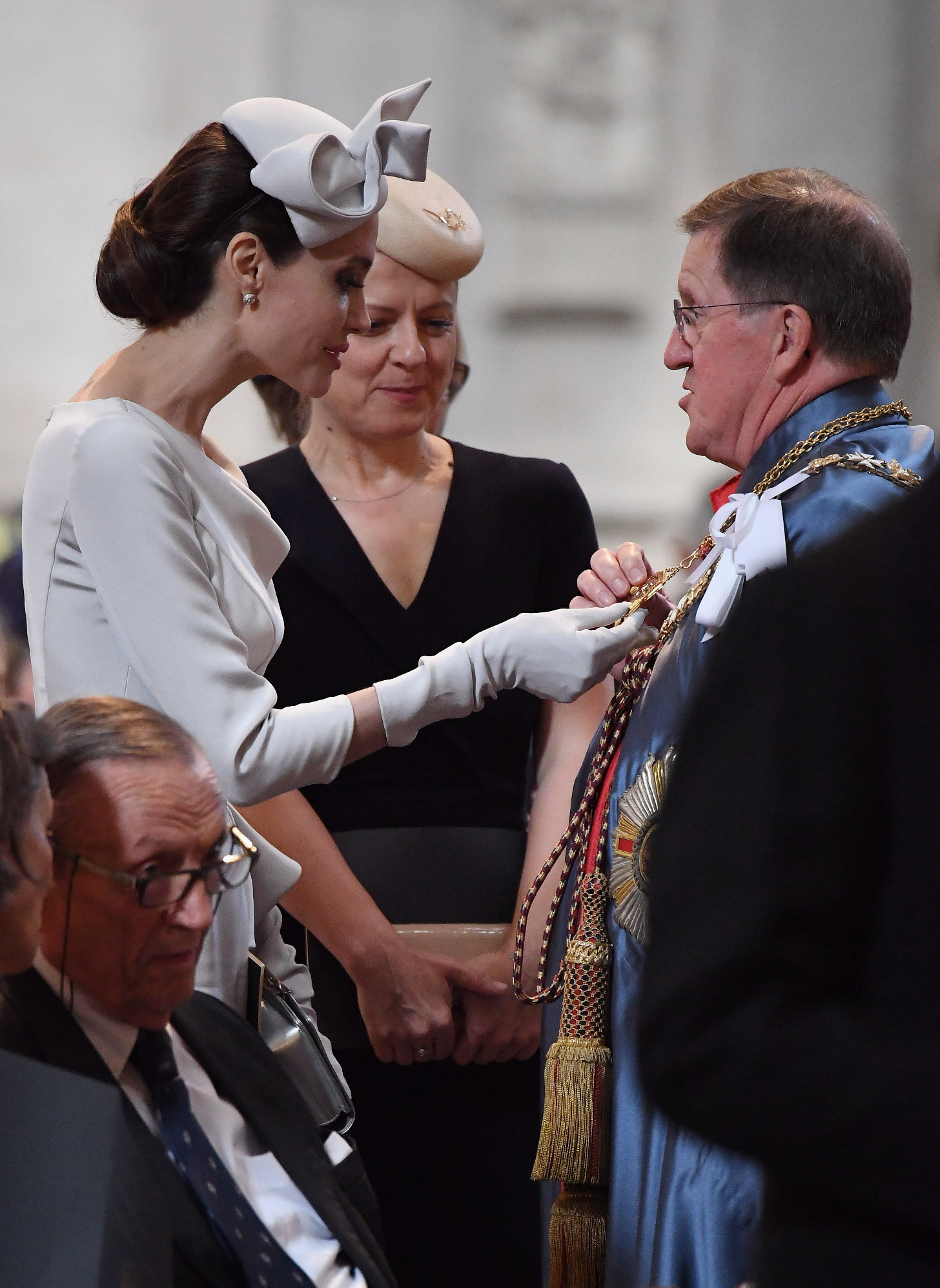 LONDON, ENGLAND - JUNE 28:  Actress and director Angelina Jolie looks at a part of the formal robes of George Robertson after arriving ahead of the Order Of St George 200th Anniversary Service at St Paul's Cathedral on June 28, 2018 in London, England.  (Photo by Leon Neal/Getty Images)