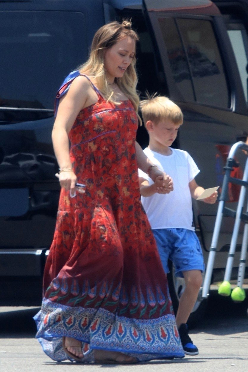 Los Angeles, CA  - *EXCLUSIVE*  - Hilary Duff was seen out with her son Luca stopping by a party store. The duo were seen leaving with a balloon that read