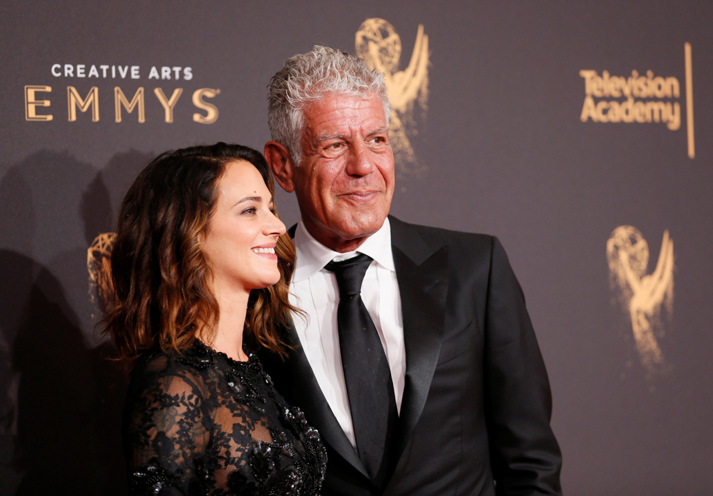 Chef Anthony Bourdain (R) and actor Asia Argento (L) pose at the 2017 Creative Arts Emmy Awards in Los Angeles, California September 9, 2017. REUTERS/Danny Moloshok - RC15E0A188A0