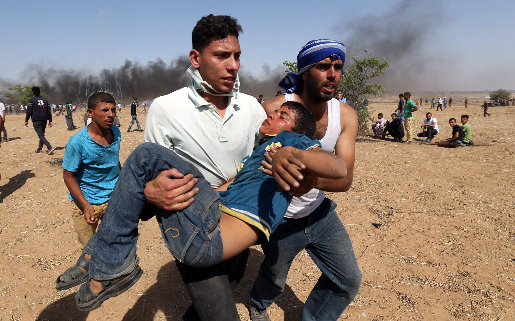 A wounded Palestinian boy is evacuated during a protest marking al-Quds Day, (Jerusalem Day), at the Israel-Gaza border in the southern Gaza Strip June 8, 2018. REUTERS/Ibraheem Abu Mustafa