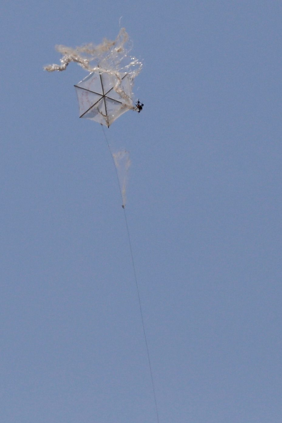 An Israeli drone intercepts a Palestinian kite in an area where kites and balloons have caused blazes, on the Israeli side of the border between Israel and the Gaza Strip, June 8, 2018. REUTERS/Amir Cohen