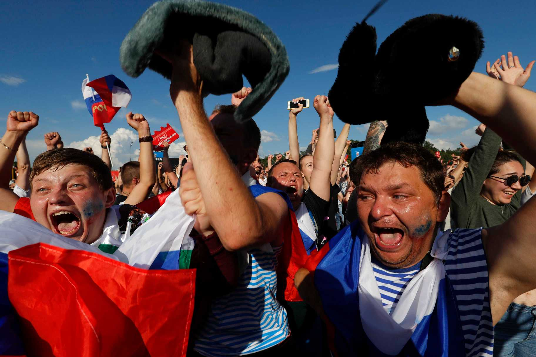 2018-07-01T163628Z_2139374975_UP1EE711A4R2U_RTRMADP_3_SOCCER-WORLDCUP-ESP-RUS-FANS-REACTIONS