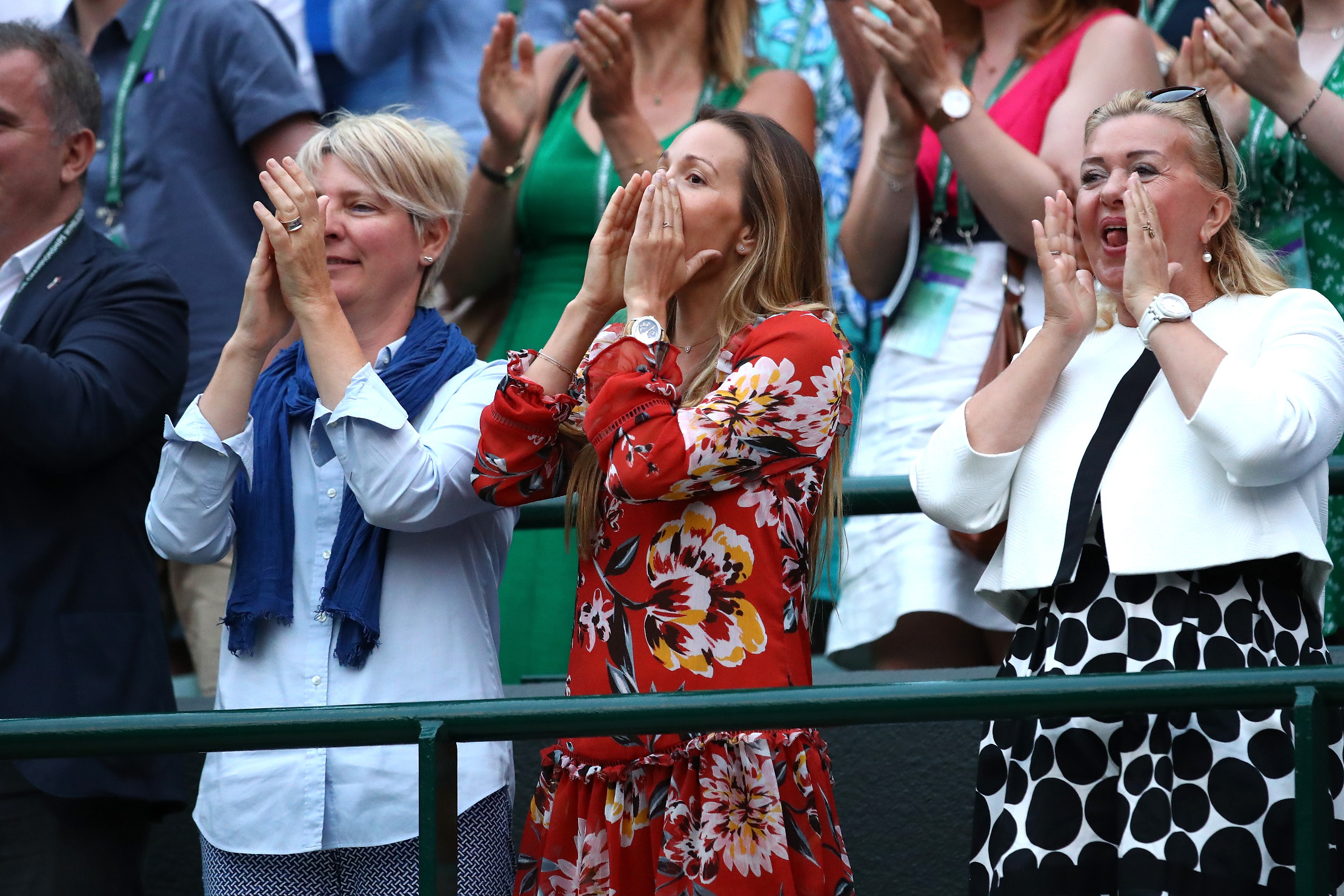 LONDON, ENGLAND - JULY 09:  Jelena Dokovic (C), wife of Novak Djokovic of Serbia, celebrates her husband's victory in the Men's Singles fourth round on day seven of the Wimbledon Lawn Tennis Championships at All England Lawn Tennis and Croquet Club on July 9, 2018 in London, England.  (Photo by Clive Brunskill/Getty Images)