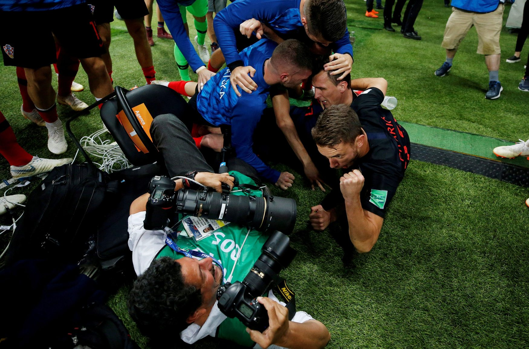 Soccer Football - World Cup - Semi Final - Croatia v England - Luzhniki Stadium, Moscow, Russia - July 11, 2018  Croatia players celebrate next to an AFP photographer Yuri Cortez after Mario Mandzukic scores their second goal   REUTERS/Carl Recine     TPX IMAGES OF THE DAY