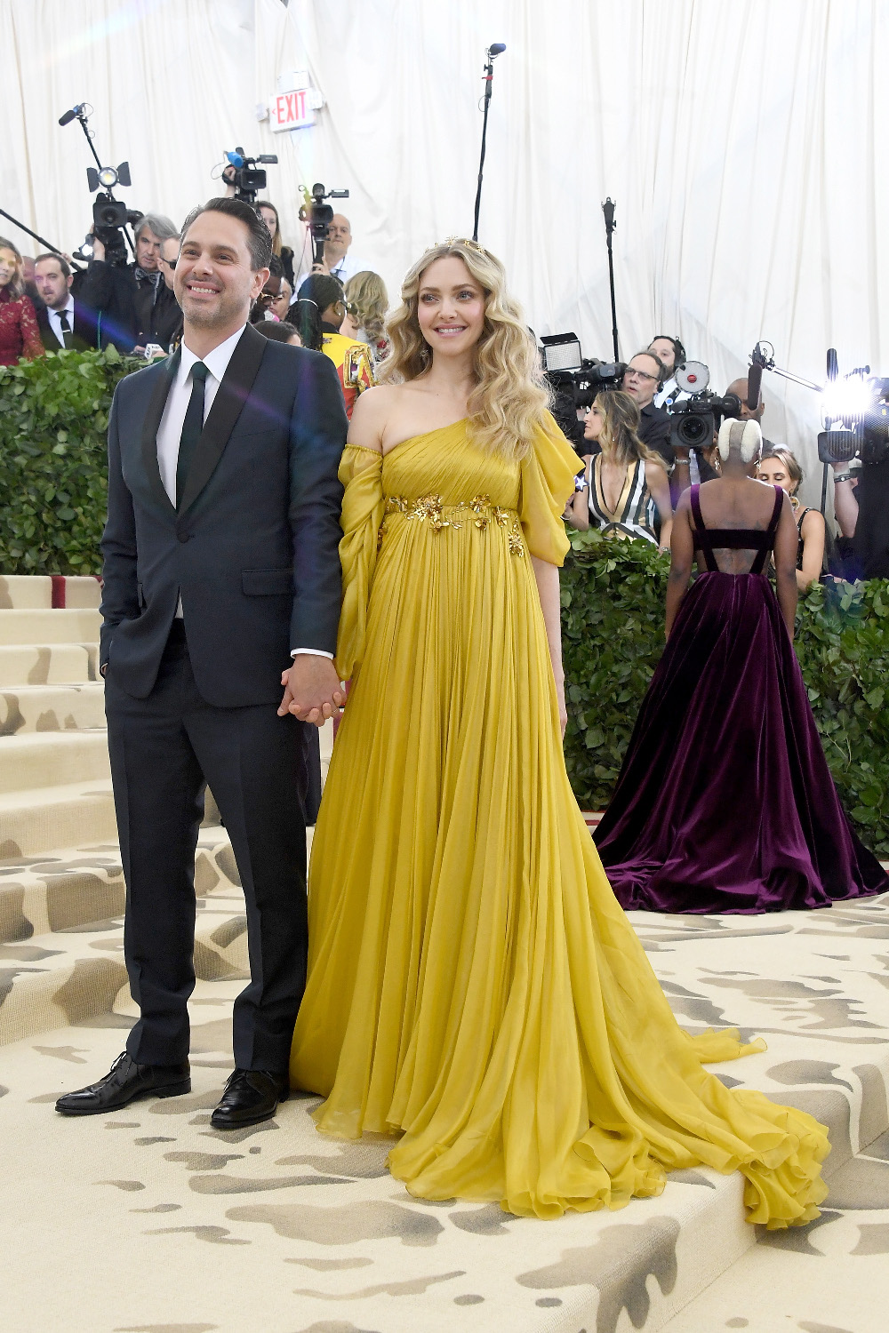 NEW YORK, NY - MAY 07:  Actors Thomas Sadoski and Amanda Seyfried attend the Heavenly Bodies: Fashion & The Catholic Imagination Costume Institute Gala at The Metropolitan Museum of Art on May 7, 2018 in New York City.  (Photo by Noam Galai/Getty Images for New York Magazine)