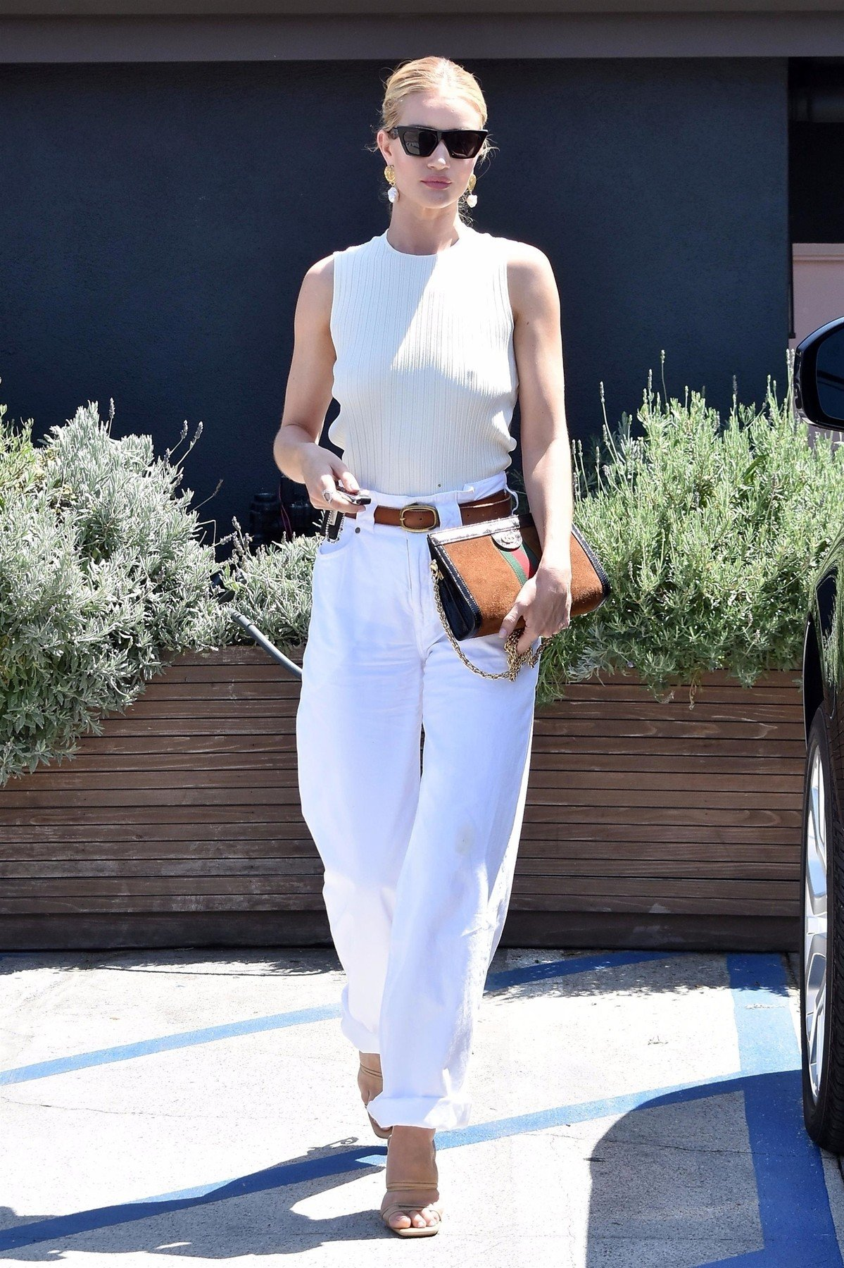 Los Angeles, CA  - *EXCLUSIVE*  - Supermodel Rosie Huntington-Whiteley was spotted at Eric Buterbaugh Florals in Los Angeles. The supermodel went braless in a white top with open back, white pants and sandals with an artistic heel.  Pictured: Rosie Huntington-Whiteley    *UK Clients - Pictures Containing Children Please Pixelate Face Prior To Publication*, Image: 377582596, License: Rights-managed, Restrictions: , Model Release: no, Credit line: Profimedia, AKM-GSI