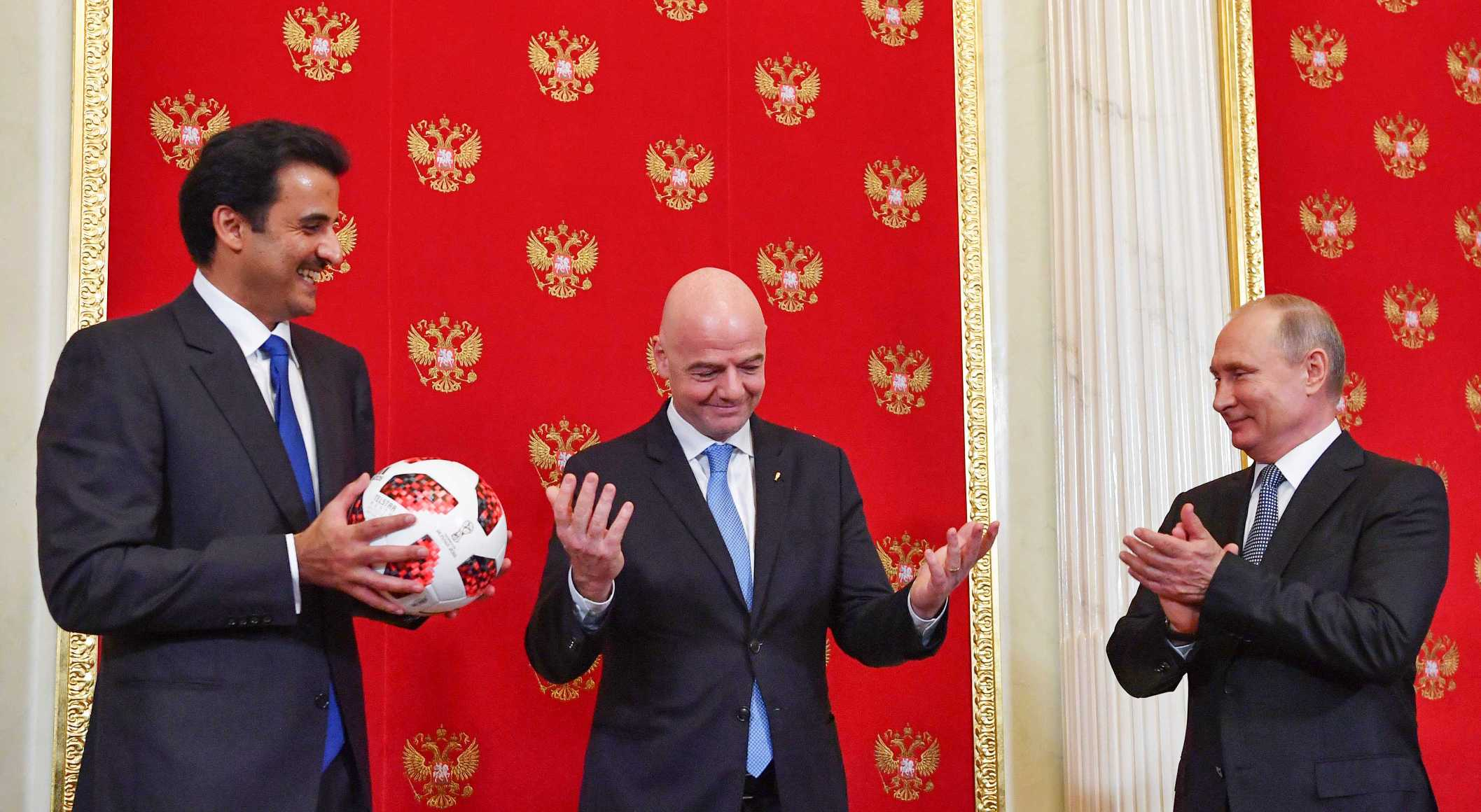 Qatar Emir Sheikh Tamim bin Hamad al-Thani, FIFA President Gianni Infantino and Russian President Vladimir Putin attend a handover ceremony for the 2022 World Cup at the Kremlin in Moscow, Russia July 15, 2018. Yuri Kadobnov/Pool via REUTERS