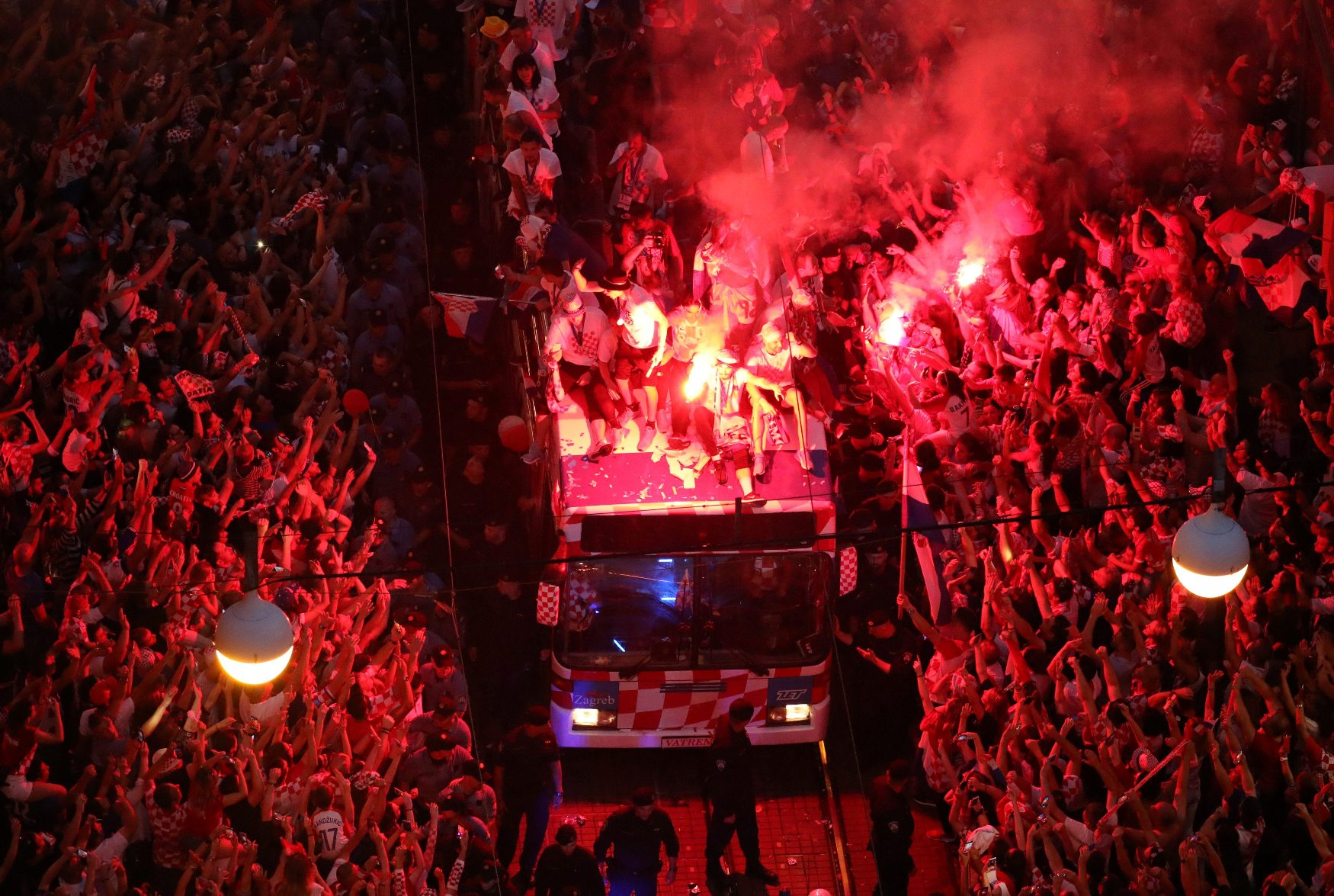 Soccer Football - World Cup - The Croatia team return from the World Cup in Russia - Zagreb, Croatia - July 16, 2018   Fans let off flares while the Croatia team bus goes past during the parade   REUTERS/Marko Djurica