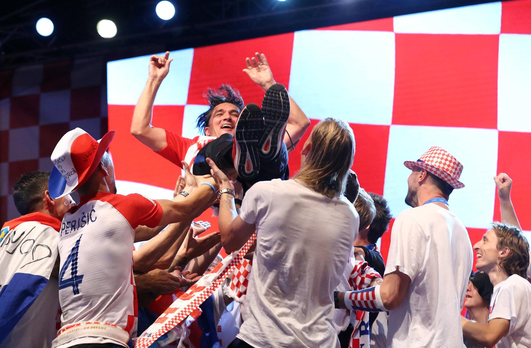 Soccer Football - World Cup - The Croatia team return from the World Cup in Russia - Zagreb, Croatia - July 16, 2018   Croatia players throw Croatia coach Zlatko Dalic in the air   REUTERS/Antonio Bronic