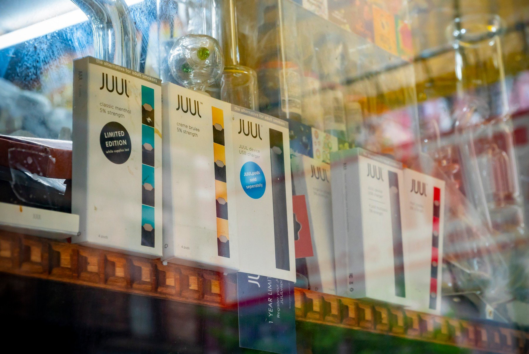 A selection of the popular Juul brand vaping supplies on display in the window of a vaping store in New York on Sunday, May 13, 2018. (Â, Image: 371659099, License: Rights-managed, Restrictions: , Model Release: no, Credit line: Profimedia, SIPA USA