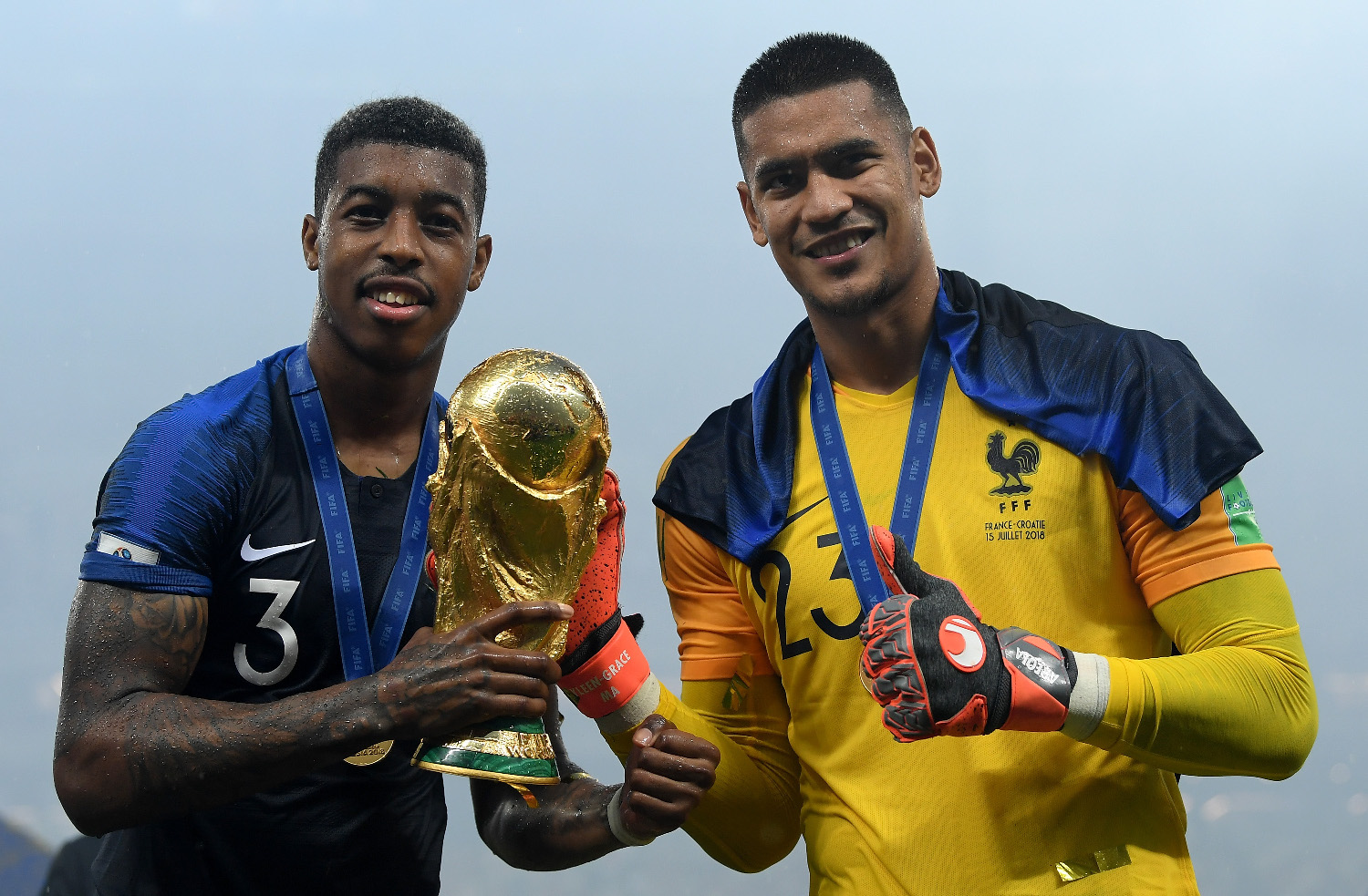 MOSCOW, RUSSIA - JULY 15:  Presnel Kimpembe and Alphonse Areola of France celebrate with the World Cup trophy following the 2018 FIFA World Cup Final between France and Croatia at Luzhniki Stadium on July 15, 2018 in Moscow, Russia.  (Photo by Matthias Hangst/Getty Images)