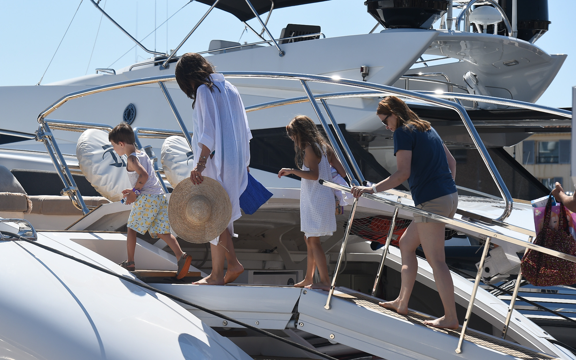 Pregnant Charlotte Casiraghi and Dimitri Rassam are seen boarding a yacht in St Tropez harbour, France  Pictured: Charlotte Casiraghi Ref: SPL5011830 230718 NON-EXCLUSIVE Picture by: Neil Warner / SplashNews.com  Splash News and Pictures Los Angeles: 310-821-2666 New York: 212-619-2666 London: 0207 644 7656 Milan: +39 02 4399 8577 Sydney: +61 02 9240 7700 photodesk@splashnews.com  World Rights