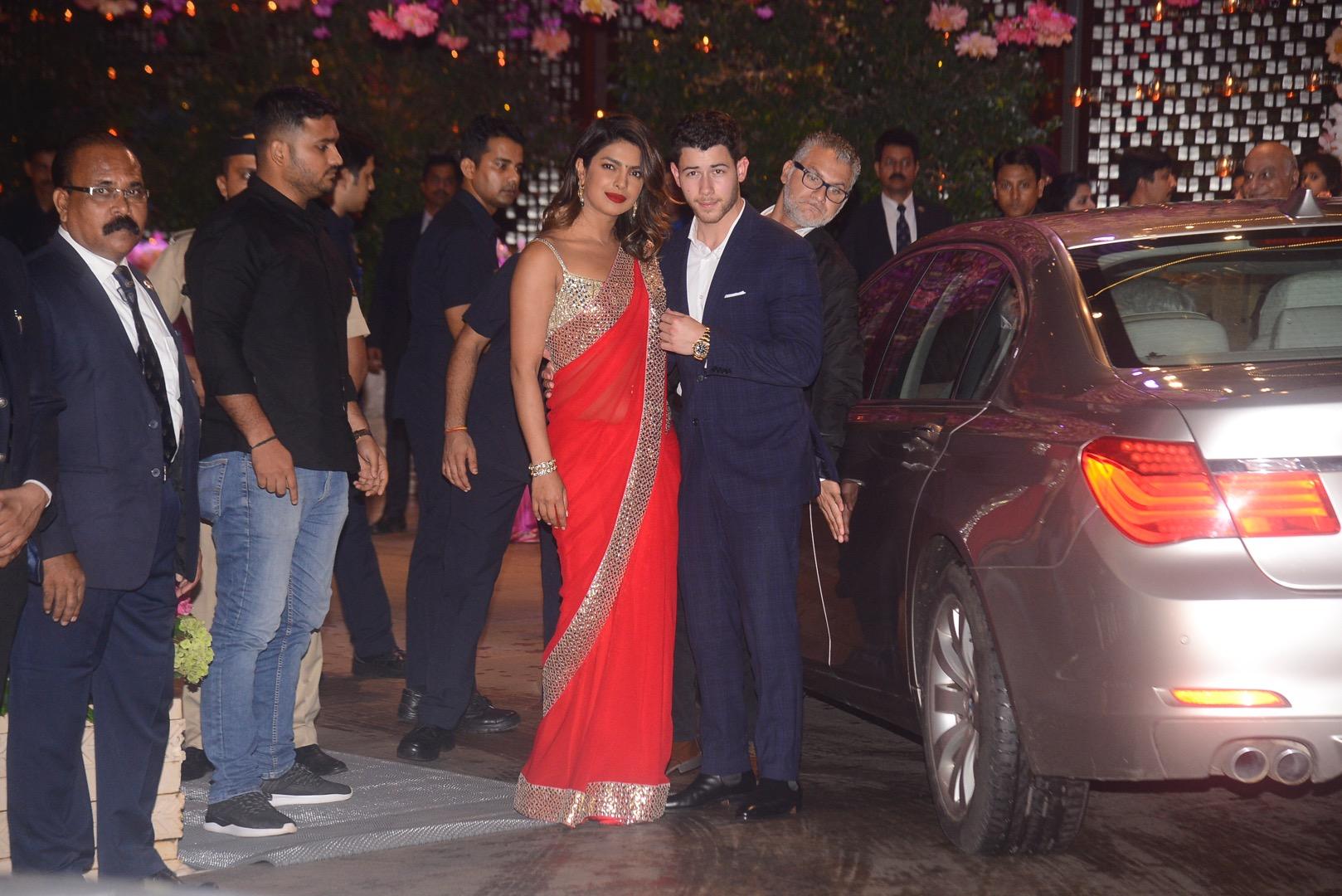 Priyanka Chopra and Nick Jonas attend Akash Ambani's pre-engagement bash in Mumbai, India. She looked stunning in a red sari dress while Nick looked smart in a suit.  Pictured: Priyanka Chopra,Nick Jonas Ref: SPL5007095 280618 NON-EXCLUSIVE Picture by: Viral Bhayani / SplashNews.com  Splash News and Pictures Los Angeles: 310-821-2666 New York: 212-619-2666 London: 0207 644 7656 Milan: +39 02 4399 8577 Sydney: +61 02 9240 7700 photodesk@splashnews.com  World Rights, No India Rights
