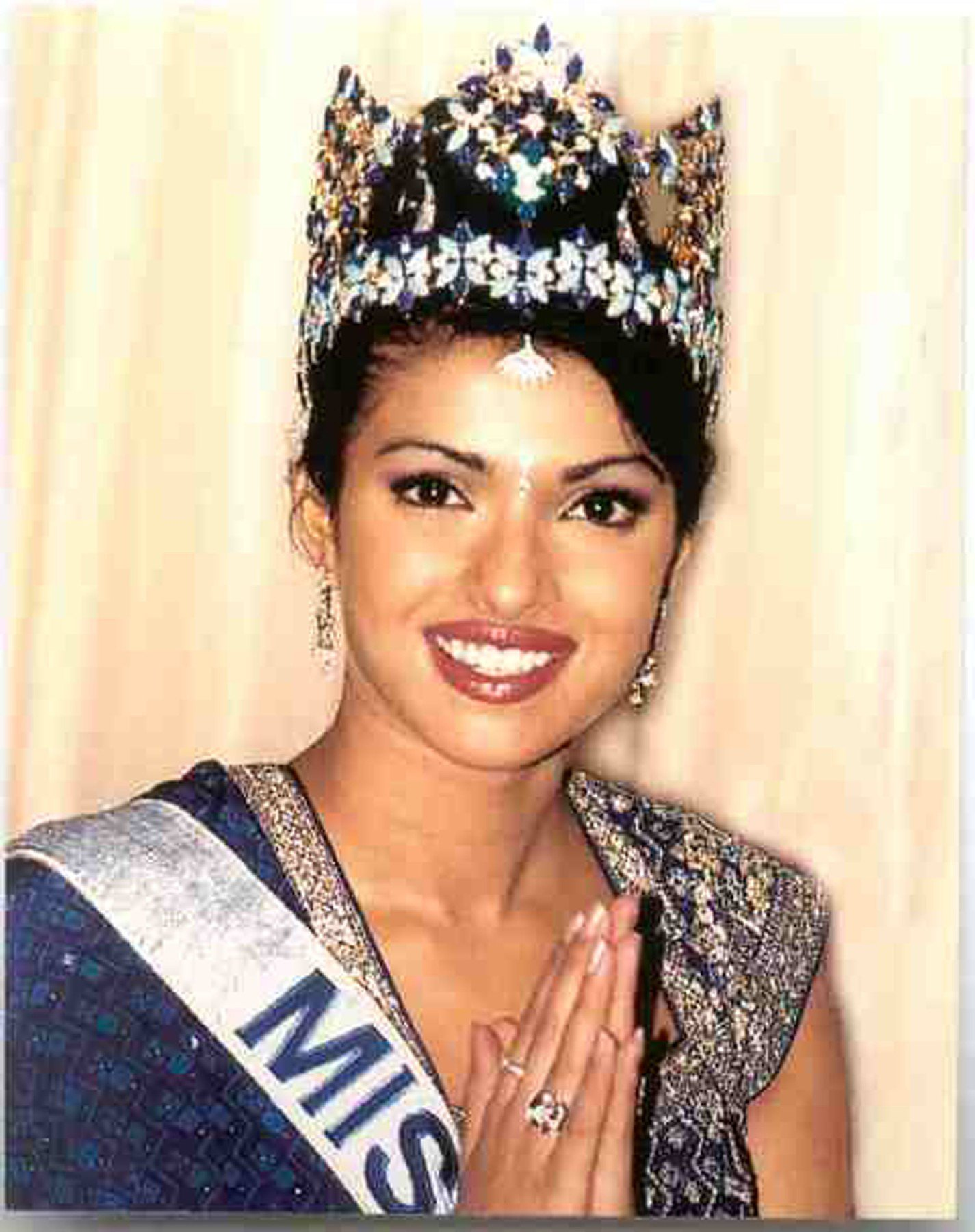 (PICTURED:Miss World 2000 - Priyanka Chopra - INDIA ) - Incredible pictures from more than 60 years of the Miss World competition show how much fashions have changed since the first show of stunners in 1951. The worlds most beautiful women have gathered in London again this year to vie for the crown of Miss World. But while contestants are often accused of being identikit models, these pictures show the difference between the first winners with their demure post-war glamour and the glitzy gowns of contestants in more recent years. ., Image: 211742463, License: Rights-managed, Restrictions: , Model Release: no, Credit line: Profimedia, Caters News
