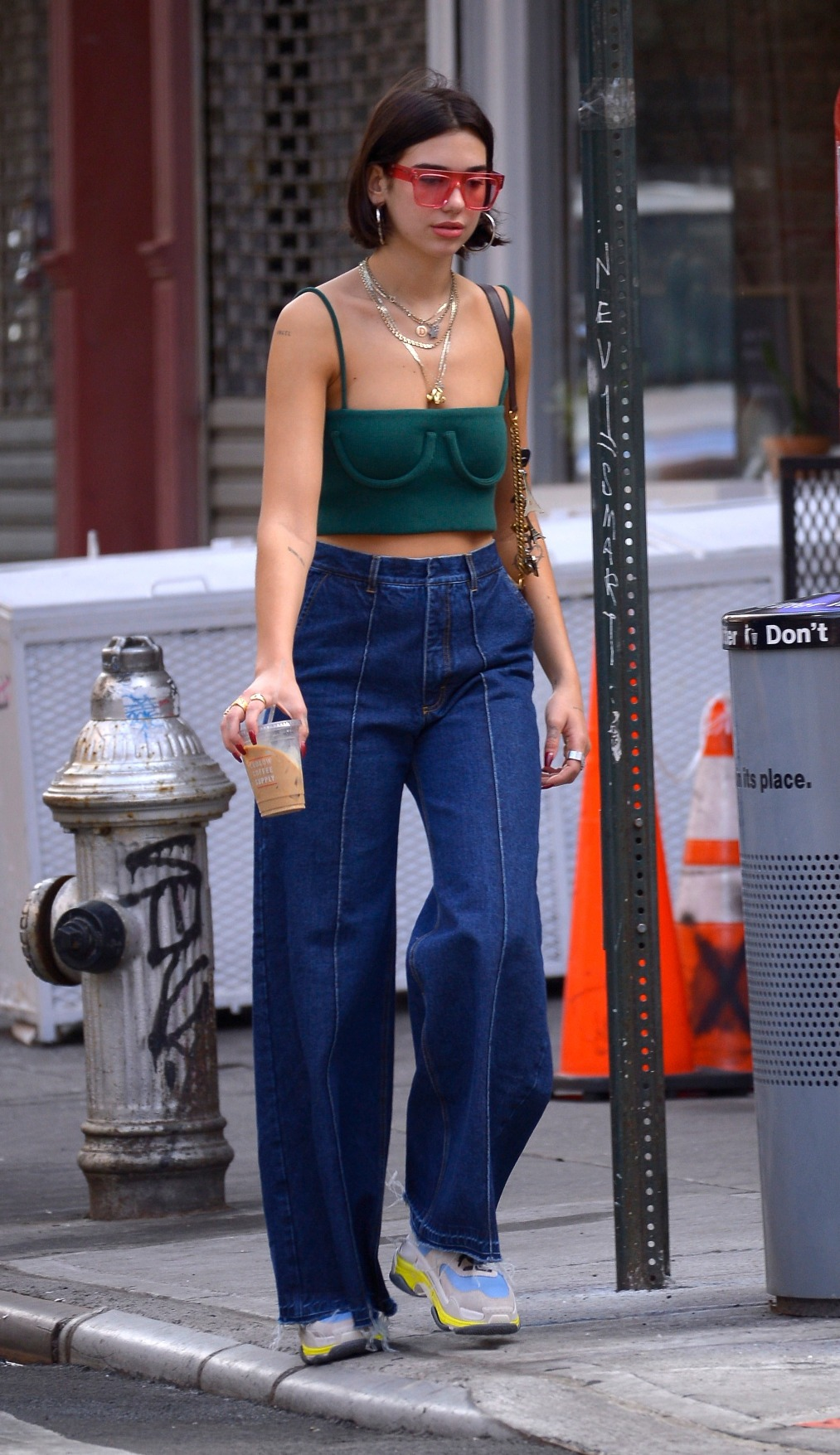EXCLUSIVE: Dua Lipa wears a cropped green top and denim flare pants with rose-colored sunglasses on a coffee run in SOHO, New York, USA.  Pictured: Dua Lipa Ref: SPL5005234 190618 EXCLUSIVE Picture by: Edward Opi / SplashNews.com  Splash News and Pictures Los Angeles: 310-821-2666 New York: 212-619-2666 London: 0207 644 7656 Milan: +39 02 4399 8577 Sydney: +61 02 9240 7700 photodesk@splashnews.com  World Rights, No Poland Rights, No Portugal Rights