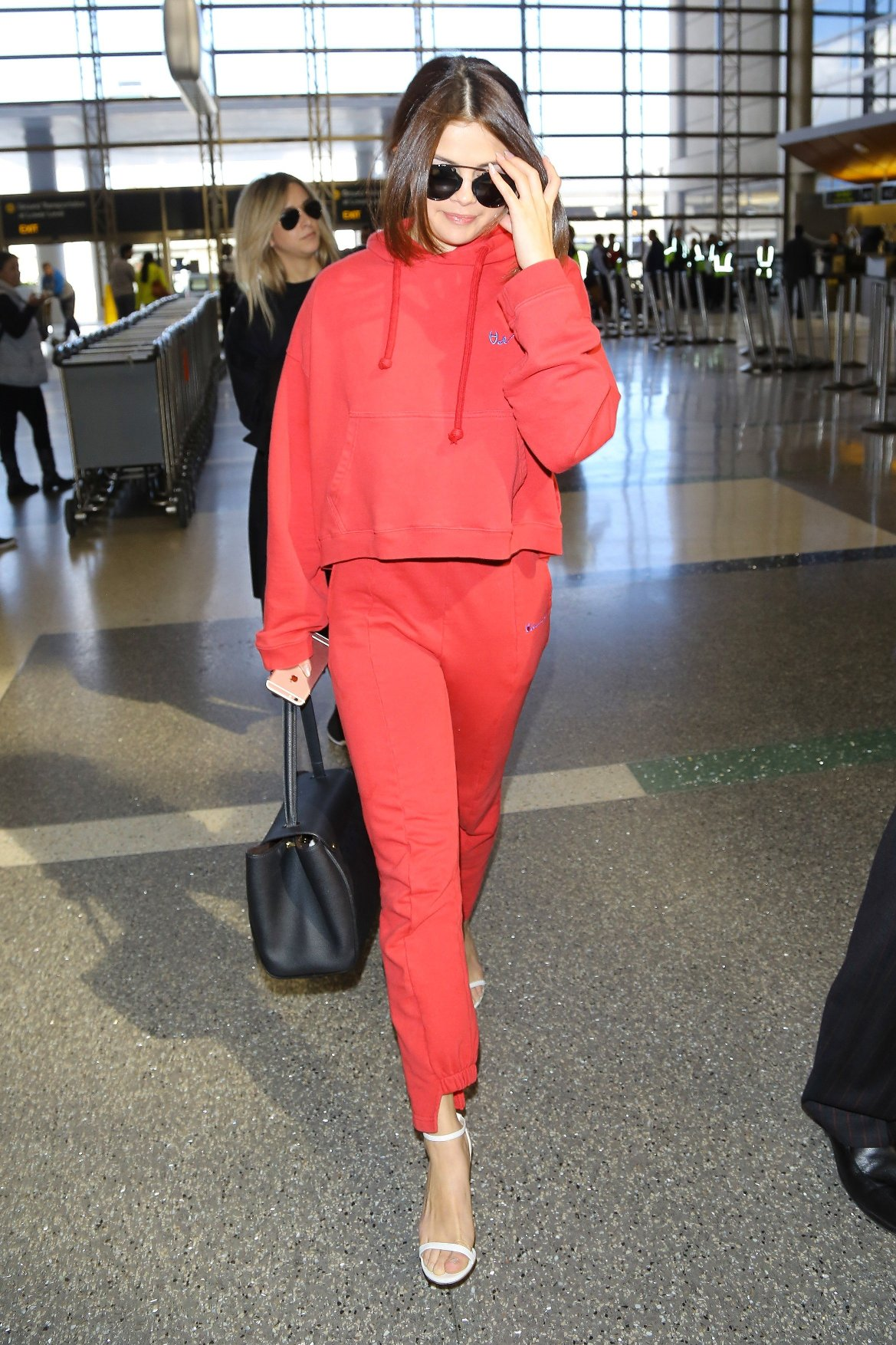 Los Angeles, CA - Selena Gomez proved that you can dress up in a pair of sweatpants and sweater but still look super chic. The singer was hard to miss in a Vetements two piece red outfit paired off with heels and designer bag. She had a sweet smile on as she walked through the terminal.          March 7, 2016, Image: 276576876, License: Rights-managed, Restrictions: NO Brazil, Model Release: no, Credit line: Profimedia, AKM-GSI