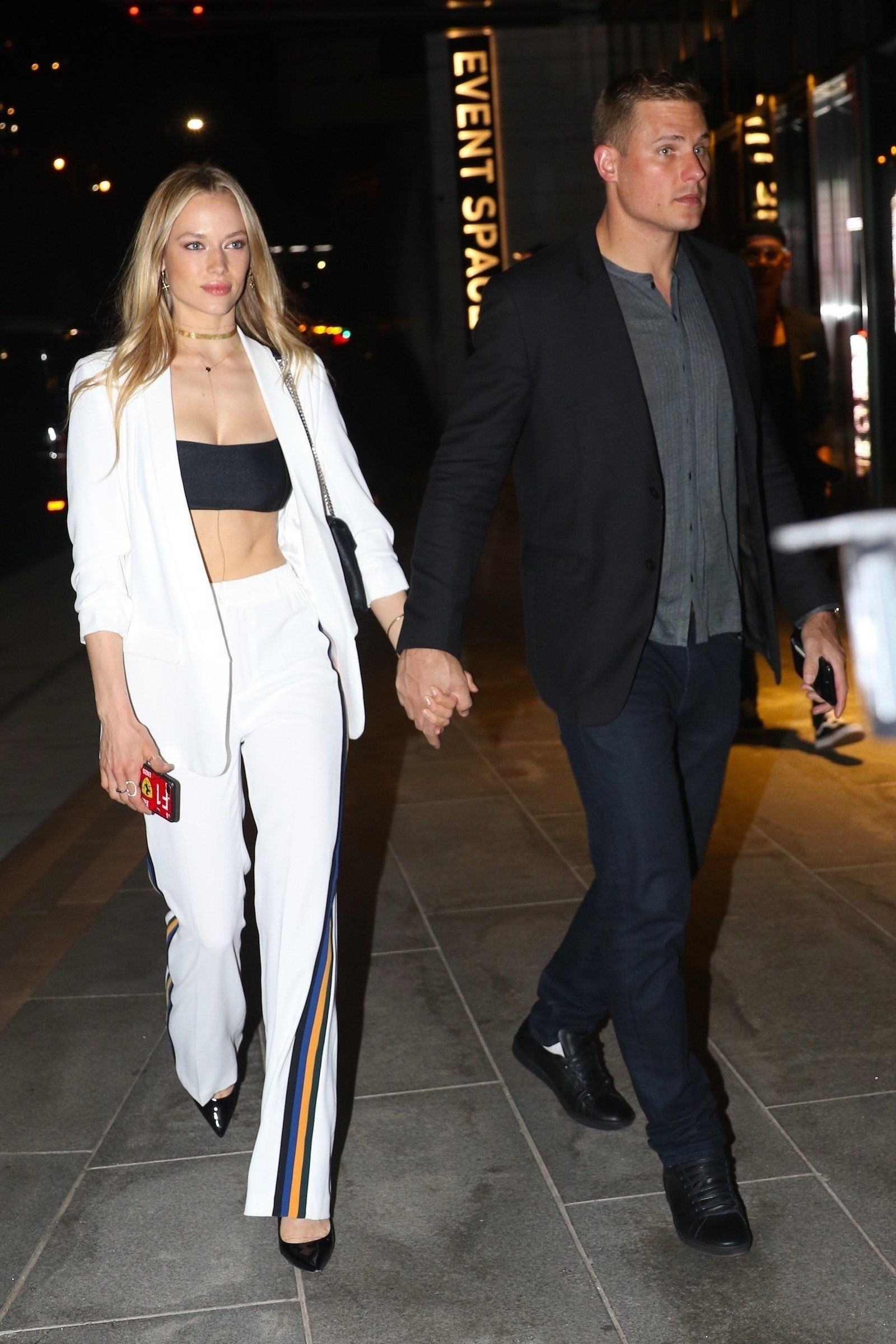 Brooklyn, NY  - Hannah Ferguson arrives with her date to the One Hotel to celebrate Gigi Hadid's 23rd birthday this evening in Brooklyn. The model opted for a more casual look in a white, tracksuit-inspired outfit and black crop top.  Pictured: Hannah Ferguson  BACKGRID USA 23 APRIL 2018, Image: 369482766, License: Rights-managed, Restrictions: , Model Release: no, Credit line: Profimedia, AKM-GSI