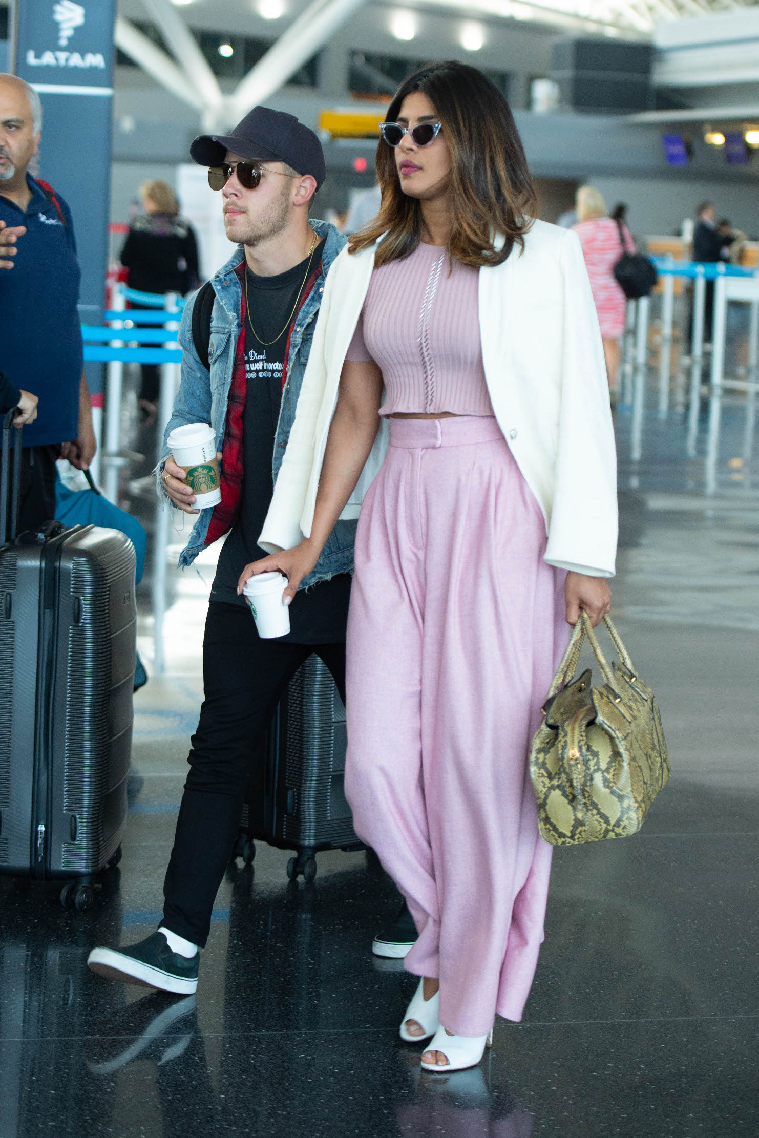 Nick Jonas and Priyanka Chopra arrive at JFK airport in NYC.  Pictured: Nick Jonas and Priyanka Chopra Ref: SPL5002447 080618 NON-EXCLUSIVE Picture by: SplashNews.com  Splash News and Pictures Los Angeles: 310-821-2666 New York: 212-619-2666 London: 0207 644 7656 Milan: +39 02 4399 8577 photodesk@splashnews.com  World Rights
