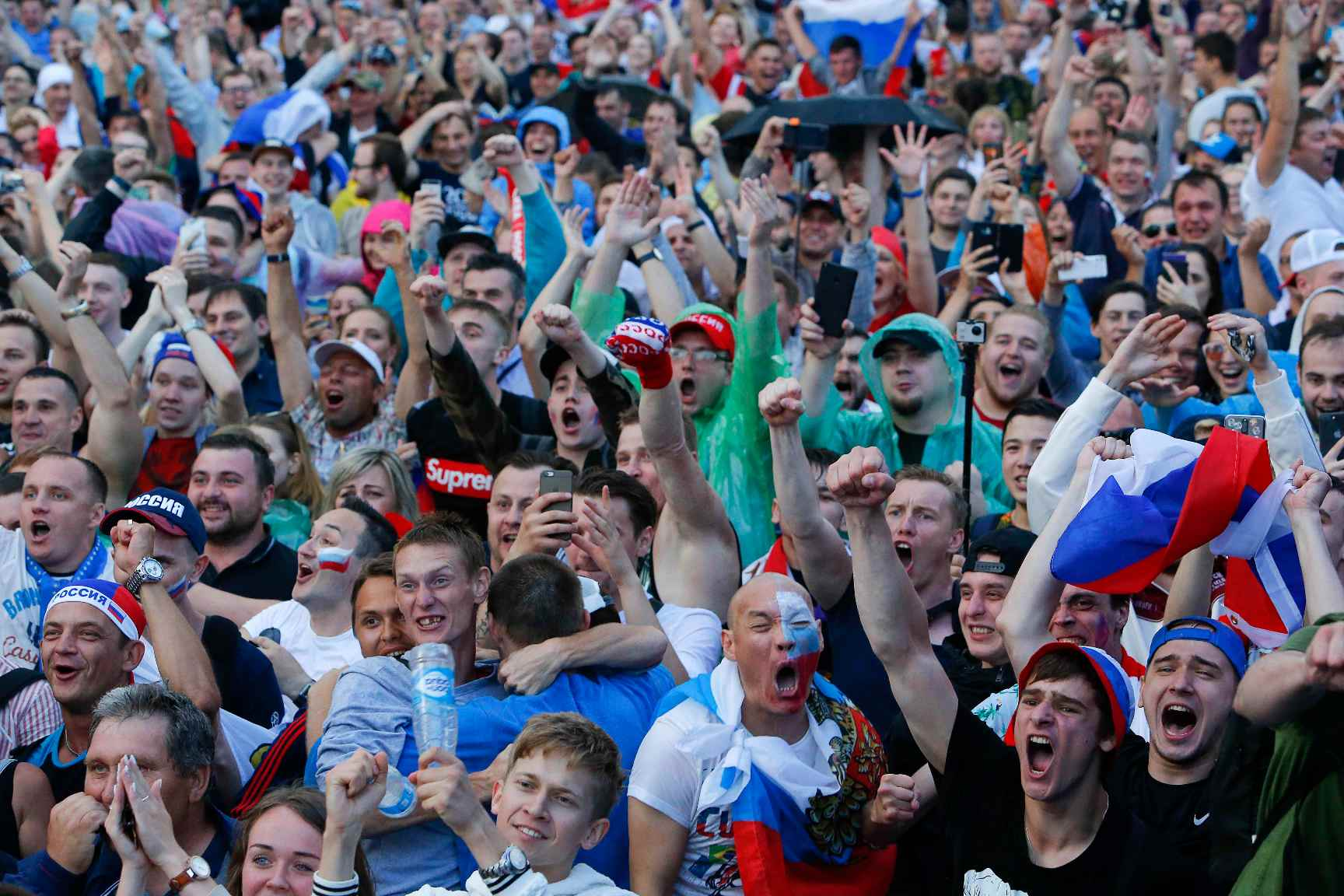 Soccer Football - World Cup - Round of 16 - Spain vs Russia - Moscow, Russia - July 1, 2018. Russian supporters react while watching the match in a fan zone. REUTERS/Sergei Karpukhin