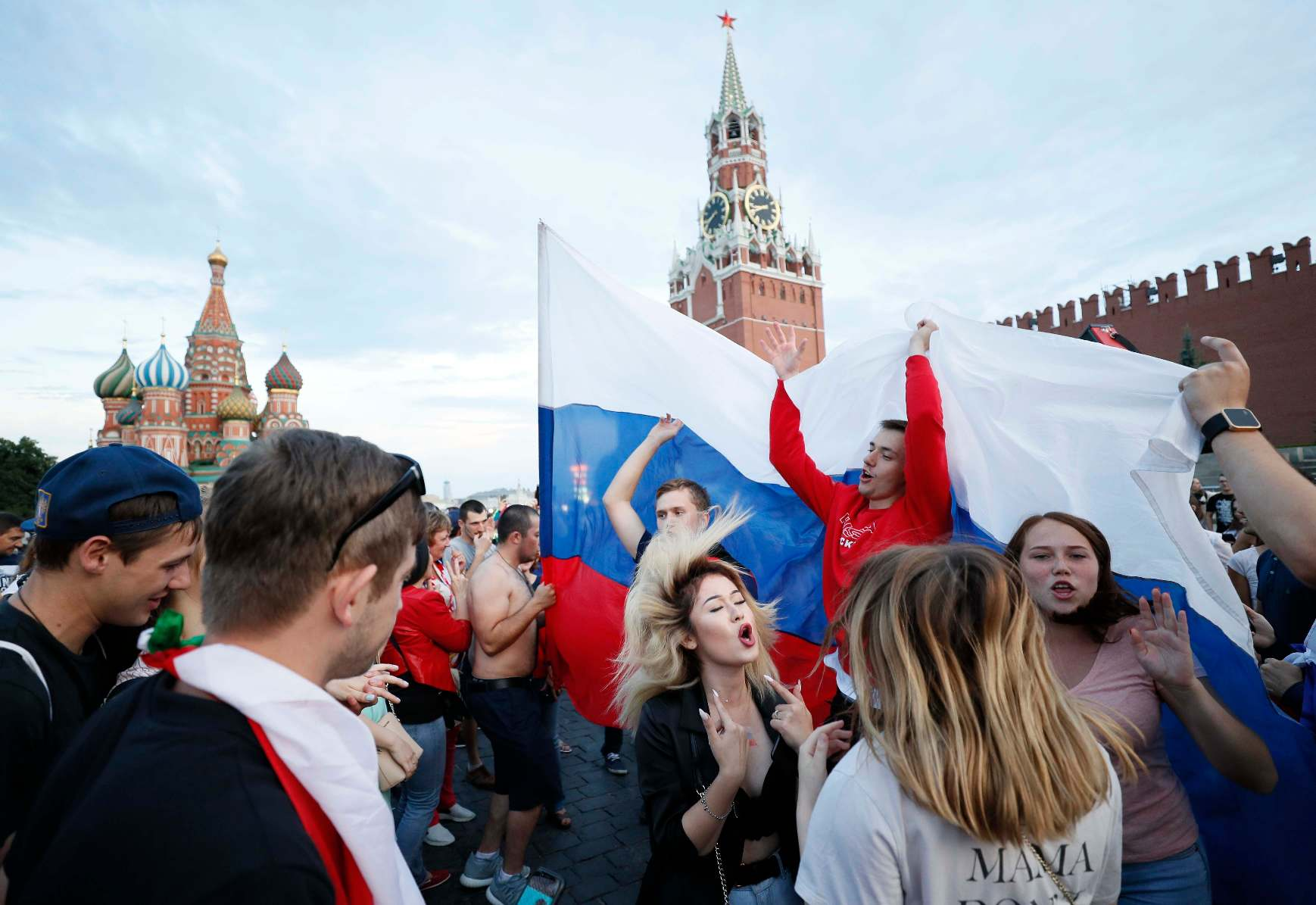 Soccer Football - World Cup - Round of 16 - Spain vs Russia - Moscow, Russia - July 1, 2018. Russian supporters celebrate the victory in Red Square. REUTERS/Gleb Garanich