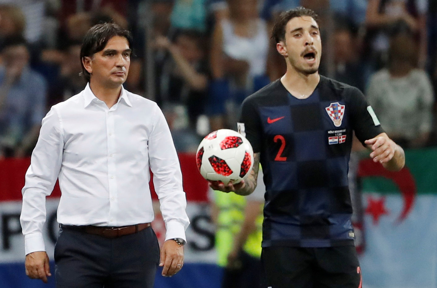 Soccer Football - World Cup - Round of 16 - Croatia vs Denmark - Nizhny Novgorod Stadium, Nizhny Novgorod, Russia - July 1, 2018  Croatia's Sime Vrsaljko prepares to take a throw in as coach Zlatko Dalic looks on  REUTERS/Carlos Barria