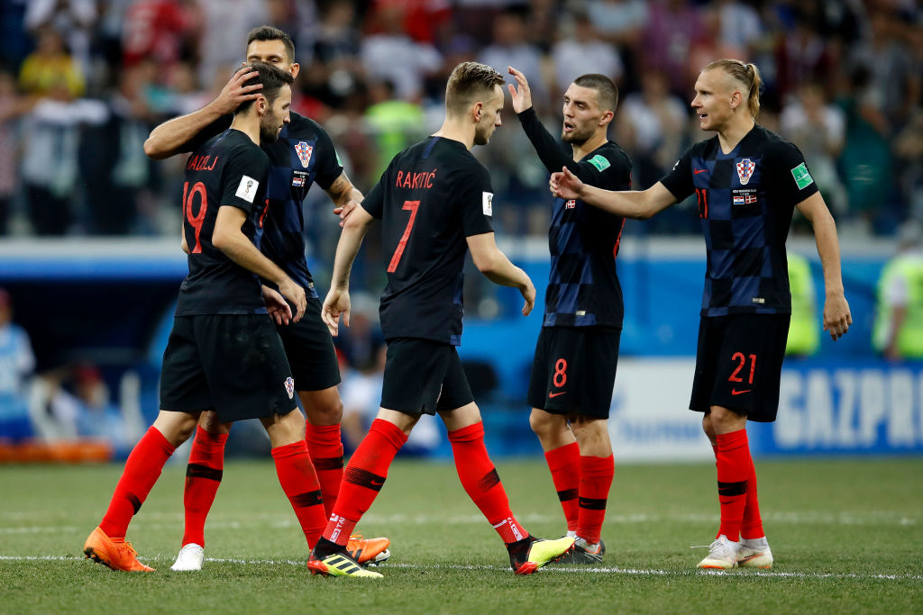 NIZHNY NOVGOROD, RUSSIA - JULY 01:  Croatia players console their team mate Milan Badelj following him missing his side's fourth penalty in the penalty shoot out during the 2018 FIFA World Cup Russia Round of 16 match between Croatia and Denmark at Nizhny Novgorod Stadium on July 1, 2018 in Nizhny Novgorod, Russia.  (Photo by Julian Finney/Getty Images)