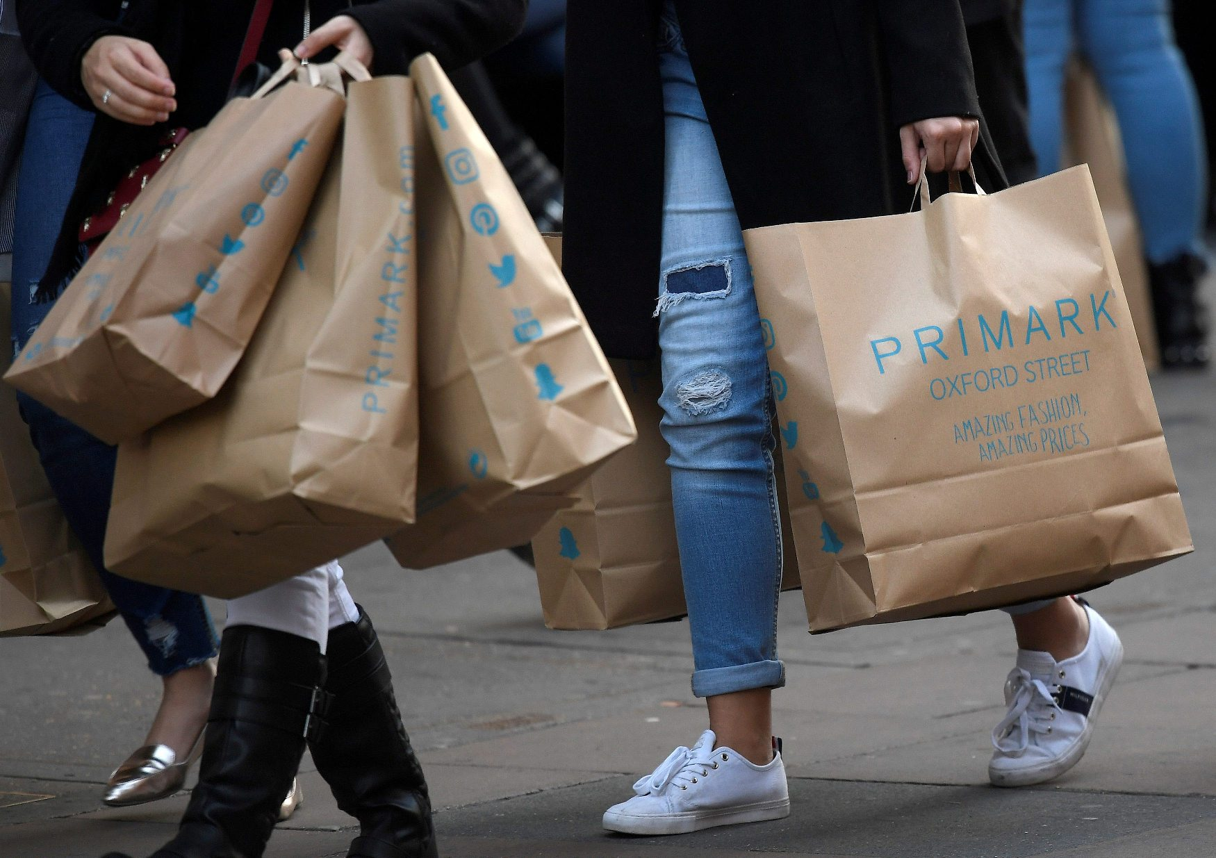 FILE PHOTO: Shoppers carry Primark bags in central London, Britain, November 3, 2017. Picture taken November 3, 2017. REUTERS/Toby Melville/File Photo