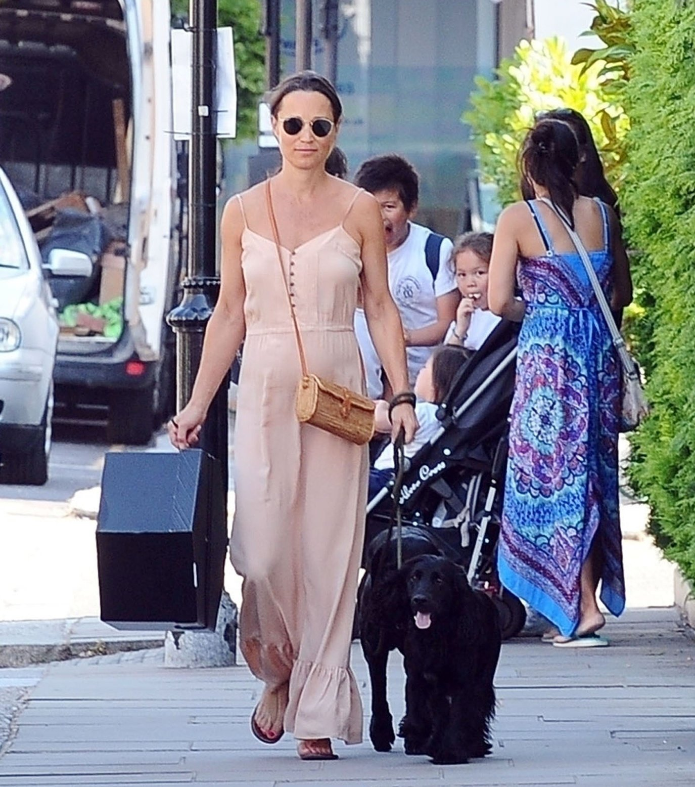 BGUK_1279146 - London, UNITED KINGDOM  - *EXCLUSIVE*  - *WEB MUST CALL FOR PRICING*  Mum-to-be Pippa Matthews looks radiant during her pregnancy in the summer sunshine on the King's Road in Chelsea. Pippa who is expecting her first child with husband James Matthews is spotted walking her dog and wore a long peach dress holding a big gift box in hand.  Pictured: Pippa Matthews - Pippa Middleton    *UK Clients - Pictures Containing Children Please Pixelate Face Prior To Publication*, Image: 376859433, License: Rights-managed, Restrictions: , Model Release: no, Credit line: Profimedia, Xposurephotos