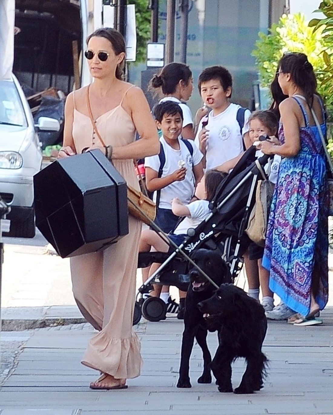 BGUK_1279146 - London, UNITED KINGDOM  - *EXCLUSIVE*  - *WEB MUST CALL FOR PRICING*  Mum-to-be Pippa Matthews looks radiant during her pregnancy in the summer sunshine on the King's Road in Chelsea. Pippa who is expecting her first child with husband James Matthews is spotted walking her dog and wore a long peach dress holding a big gift box in hand.  Pictured: Pippa Matthews - Pippa Middleton    *UK Clients - Pictures Containing Children Please Pixelate Face Prior To Publication*, Image: 376859447, License: Rights-managed, Restrictions: , Model Release: no, Credit line: Profimedia, Xposurephotos