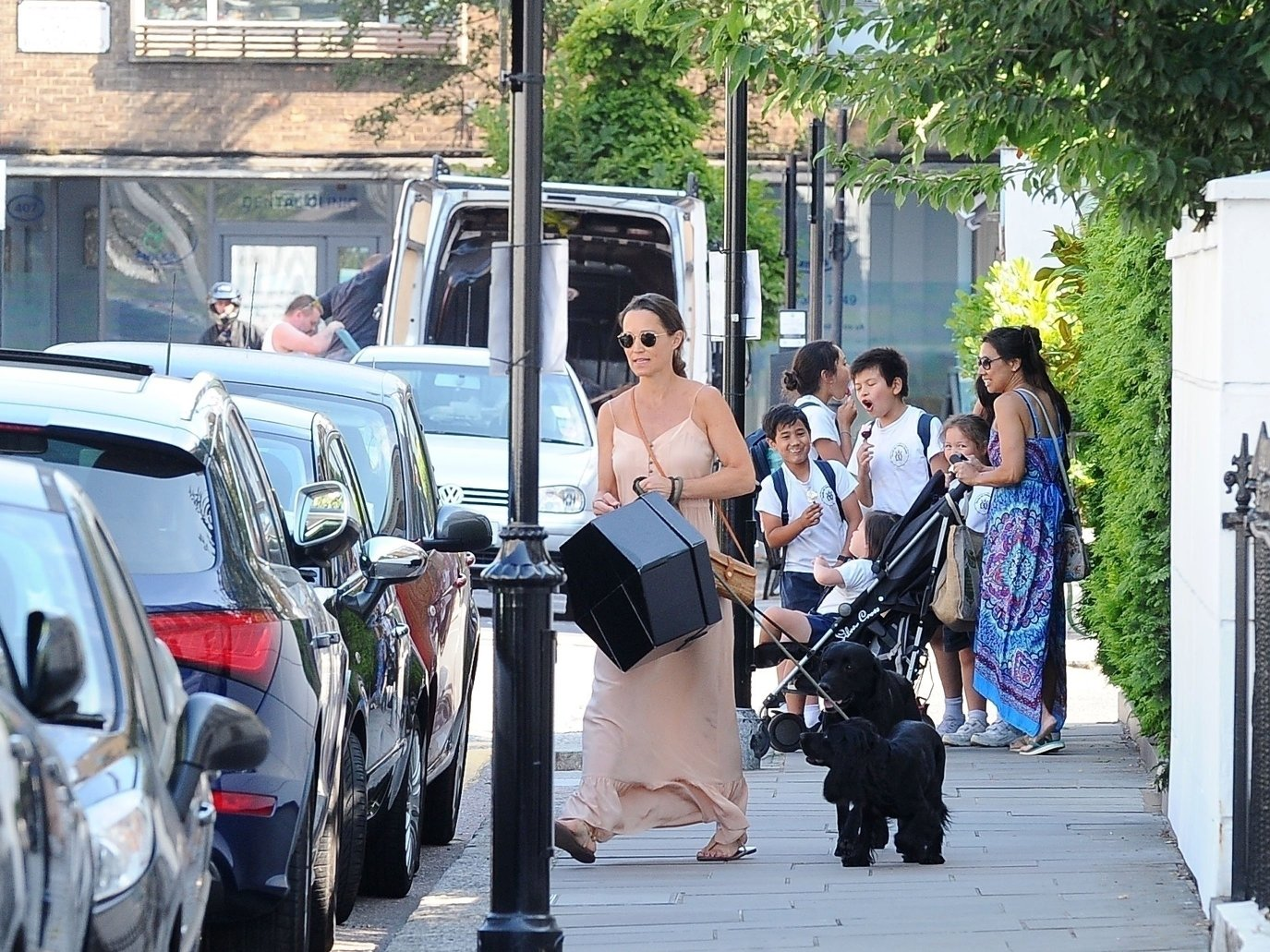BGUK_1279146 - London, UNITED KINGDOM  - *EXCLUSIVE*  - *WEB MUST CALL FOR PRICING*  Mum-to-be Pippa Matthews looks radiant during her pregnancy in the summer sunshine on the King's Road in Chelsea. Pippa who is expecting her first child with husband James Matthews is spotted walking her dog and wore a long peach dress holding a big gift box in hand.  Pictured: Pippa Matthews - Pippa Middleton    *UK Clients - Pictures Containing Children Please Pixelate Face Prior To Publication*, Image: 376859448, License: Rights-managed, Restrictions: , Model Release: no, Credit line: Profimedia, Xposurephotos