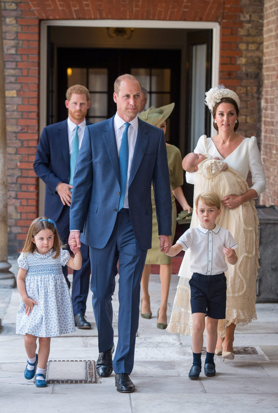 Britain's Princess Charlotte and Prince George hold the hands of their father, William, the Duke of Cambridge, as they arrive for the christening of their brother, Prince Louis, who is being carried by their mother, Catherine, the Duchess of Cambridge, at the Chapel Royal, St James's Palace, London, Britain, July 9, 2018. Dominic Lipinski/Pool via REUTERS
