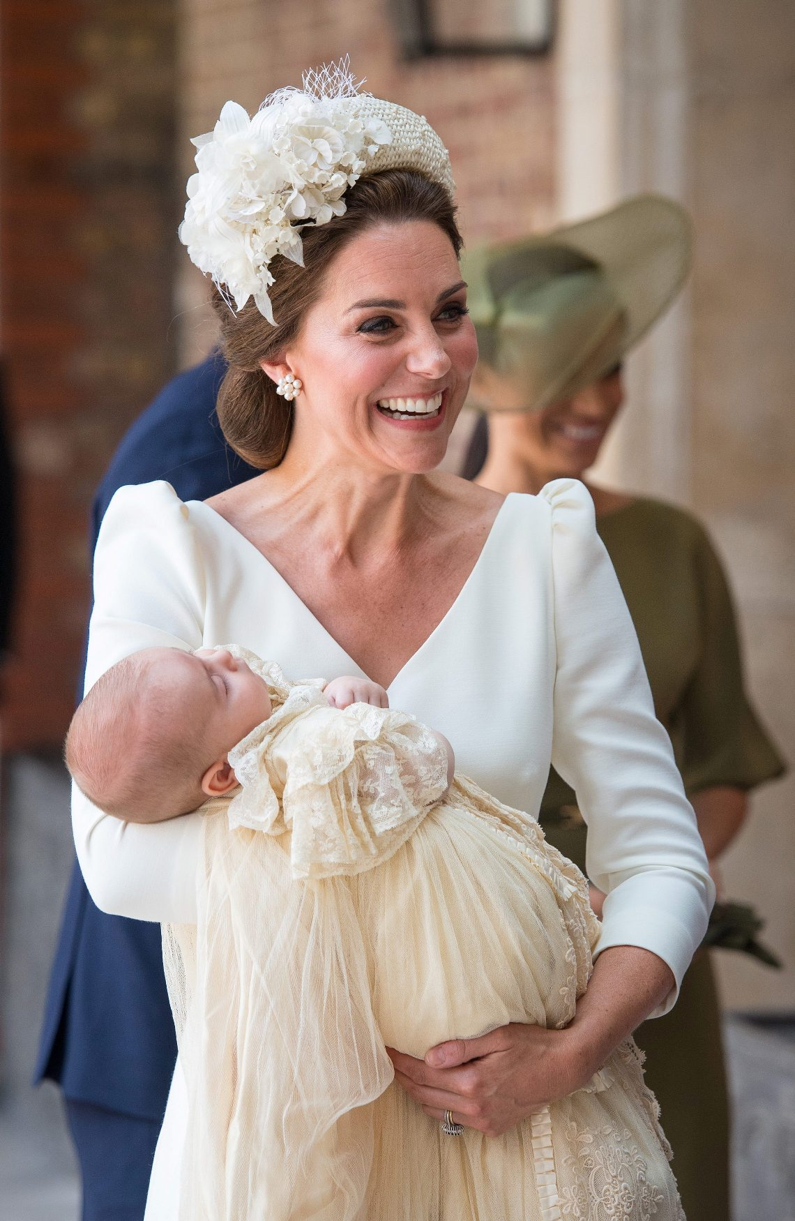 Britain's Catherine, the Duchess of Cambridge, carries Prince Louis as they arrive for his christening service at the Chapel Royal, St James's Palace, London, Britain, July 9, 2018. Dominic Lipinski/Pool via REUTERS