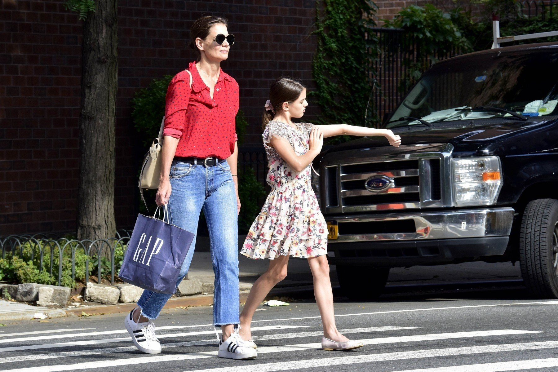 ** RIGHTS: WORLDWIDE EXCEPT IN BELGIUM, FRANCE, GERMANY, NETHERLANDS, POLAND, SPAIN ** New York, NY  - *EXCLUSIVE*Katie Holmes shares a hug with her daughter Suri while they spend some quality time walking around the