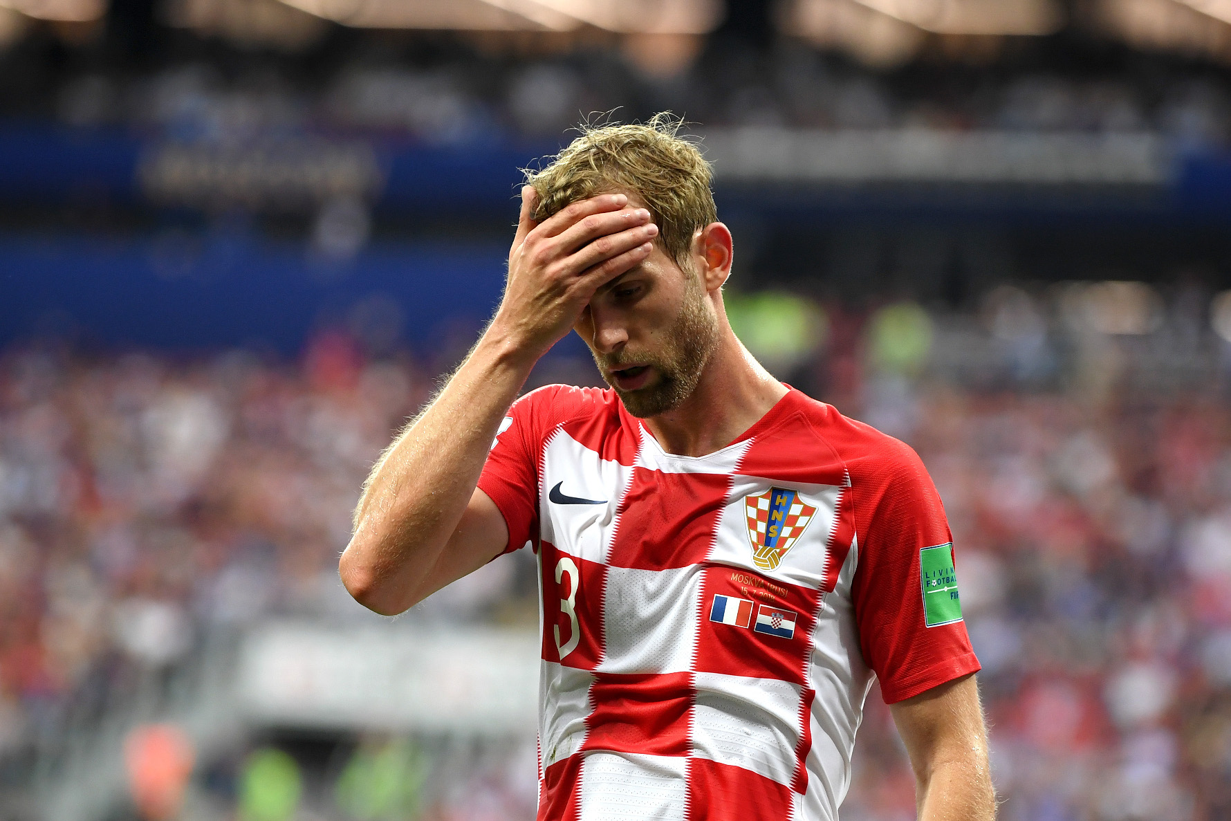 MOSCOW, RUSSIA - JULY 15:  Ivan Strinic of Croatia stands dejected during the 2018 FIFA World Cup Final between France and Croatia at Luzhniki Stadium on July 15, 2018 in Moscow, Russia.  (Photo by Matthias Hangst/Getty Images)