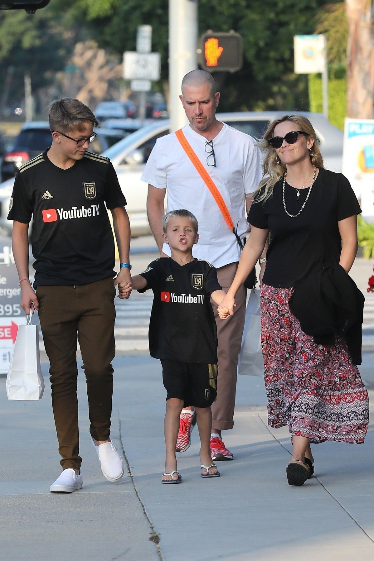 Brentwood, CA  - Reese Witherspoon held hands with her husband Jim Toth as she and her two sons Tennessee and Deacon Phillippe left Amici restaurant after an early Sunday dinner in Brentwood.  Pictured: Reese Witherspoon, Jim Toth, Tennessee Phillippe, Deacon Phillippe  BACKGRID USA 19 AUGUST 2018, Image: 383182899, License: Rights-managed, Restrictions: , Model Release: no, Credit line: Profimedia, AKM-GSI
