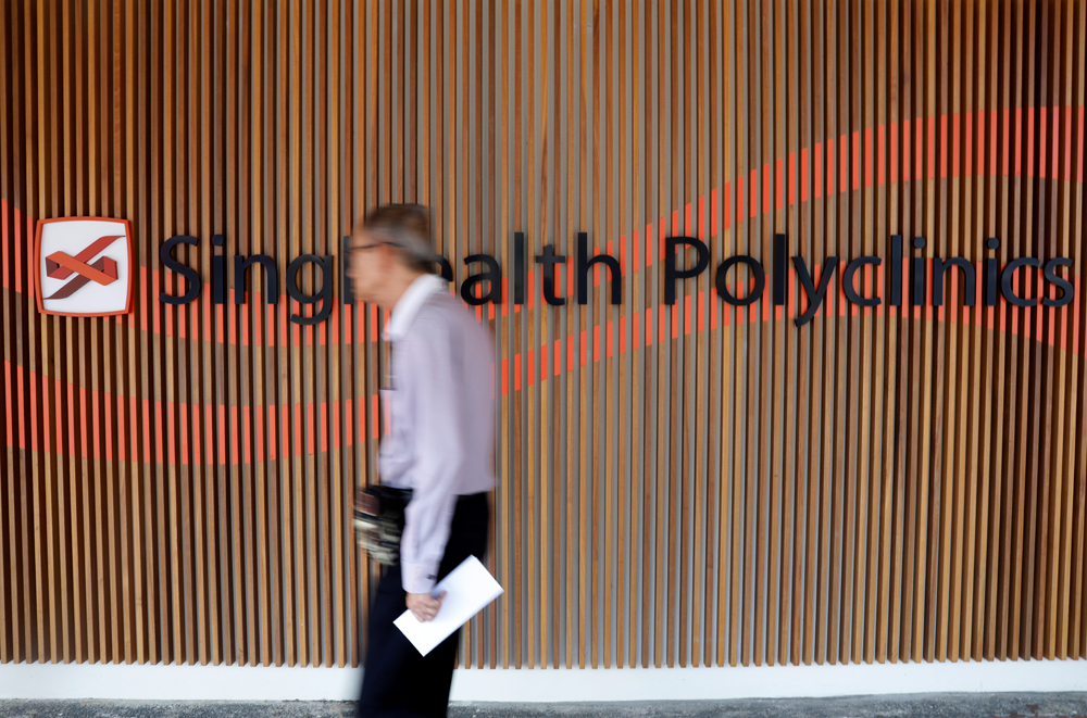 A SingHealth polyclinic signage is pictured in Singapore July 23, 2018. REUTERS/Edgar Su - RC1265EF2790
