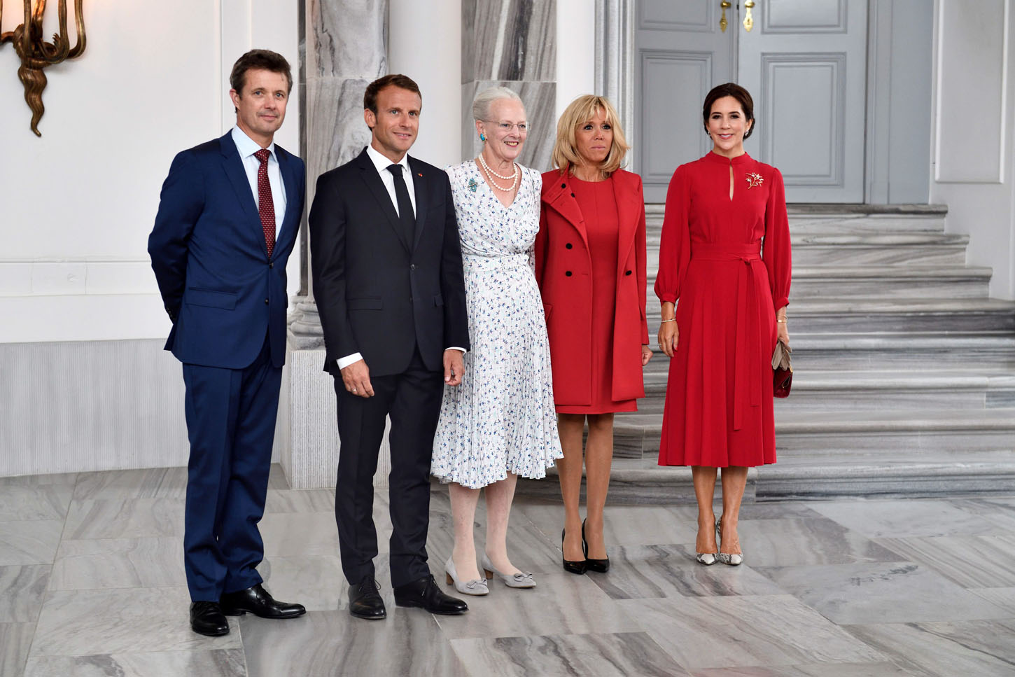 Queen Margrethe of Denmark, Crown Prince Frederik of Denmark, Crown Princess Mary, French President Emmanuel Macron and his wife Brigitte Macron are seen at Amalienborg Castle in Copenhagen, Denmark August 28, 2018. Ritzau Scanpix/Tariq Mikkel Khan via REUTERS    ATTENTION EDITORS - THIS IMAGE WAS PROVIDED BY A THIRD PARTY. DENMARK OUT. NO COMMERCIAL OR EDITORIAL SALES IN DENMARK.