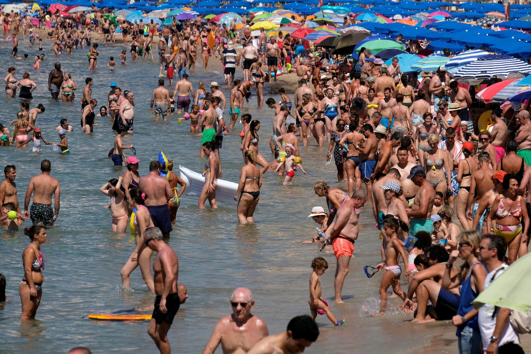 People cool off at the beach during the heatwave in the southeastern coastal town of Benidorm, Spain, August 2, 2018. REUTERS/Heino Kalis
